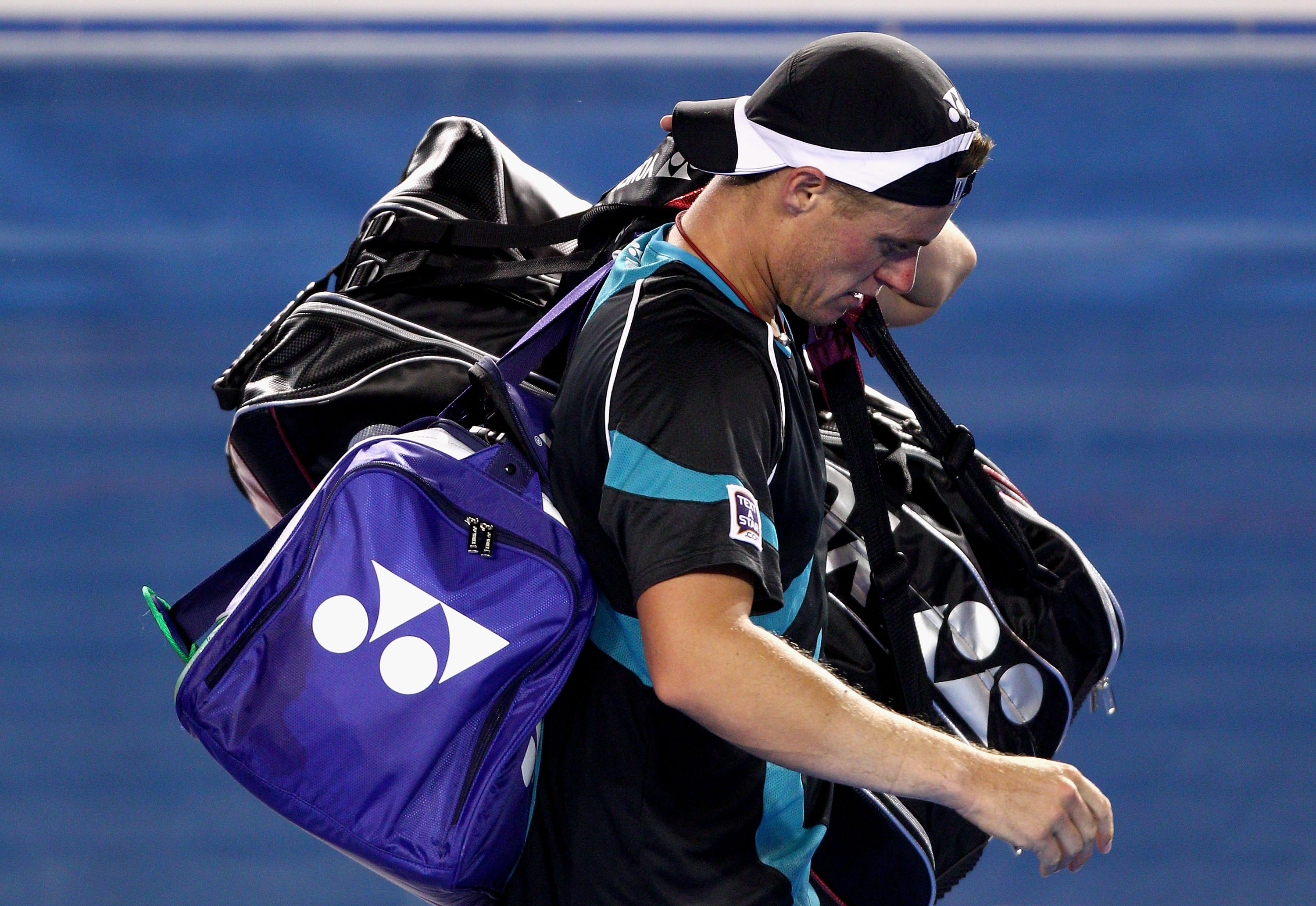 MELBOURNE, AUSTRALIA - JANUARY 18:  Lleyton Hewitt of Australia walks off Rod Laver Arena after losing his first round match against David Nalbandian of Argentina during day two of the 2011 Australian Open at Melbourne Park on January 18, 2011 in Melbourn