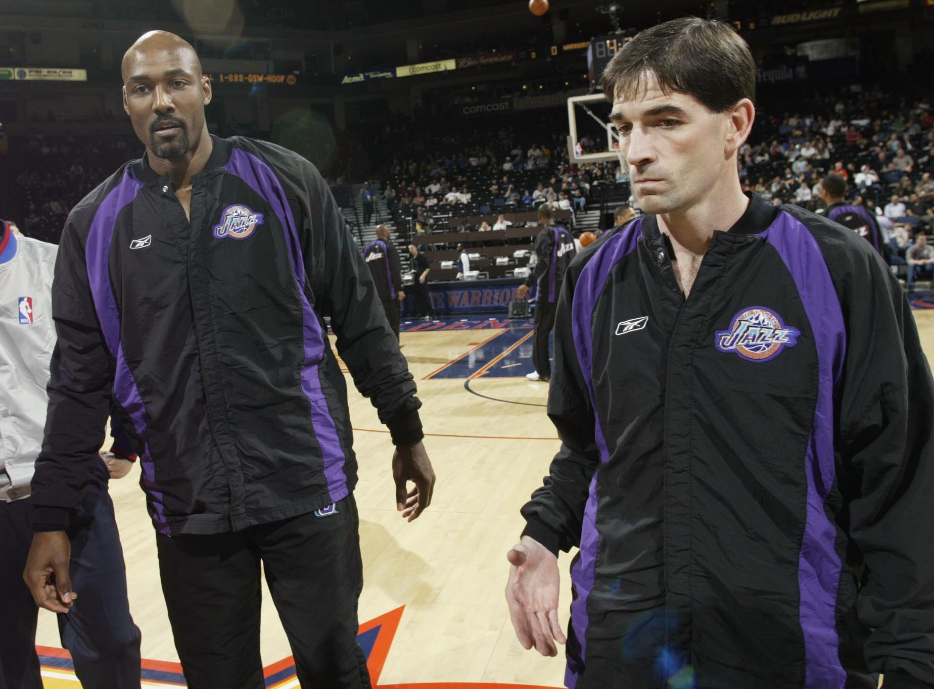 OAKLAND, CA - APRIL 8:  Karl Malone #32 and John Stockton #12 of the Utah Jazz before a game against the Golden State Warriors at the Network Associates Coliseum on April 8, 2003 in Oakland, California. NOTE TO USER: User expressly acknowledges and agrees