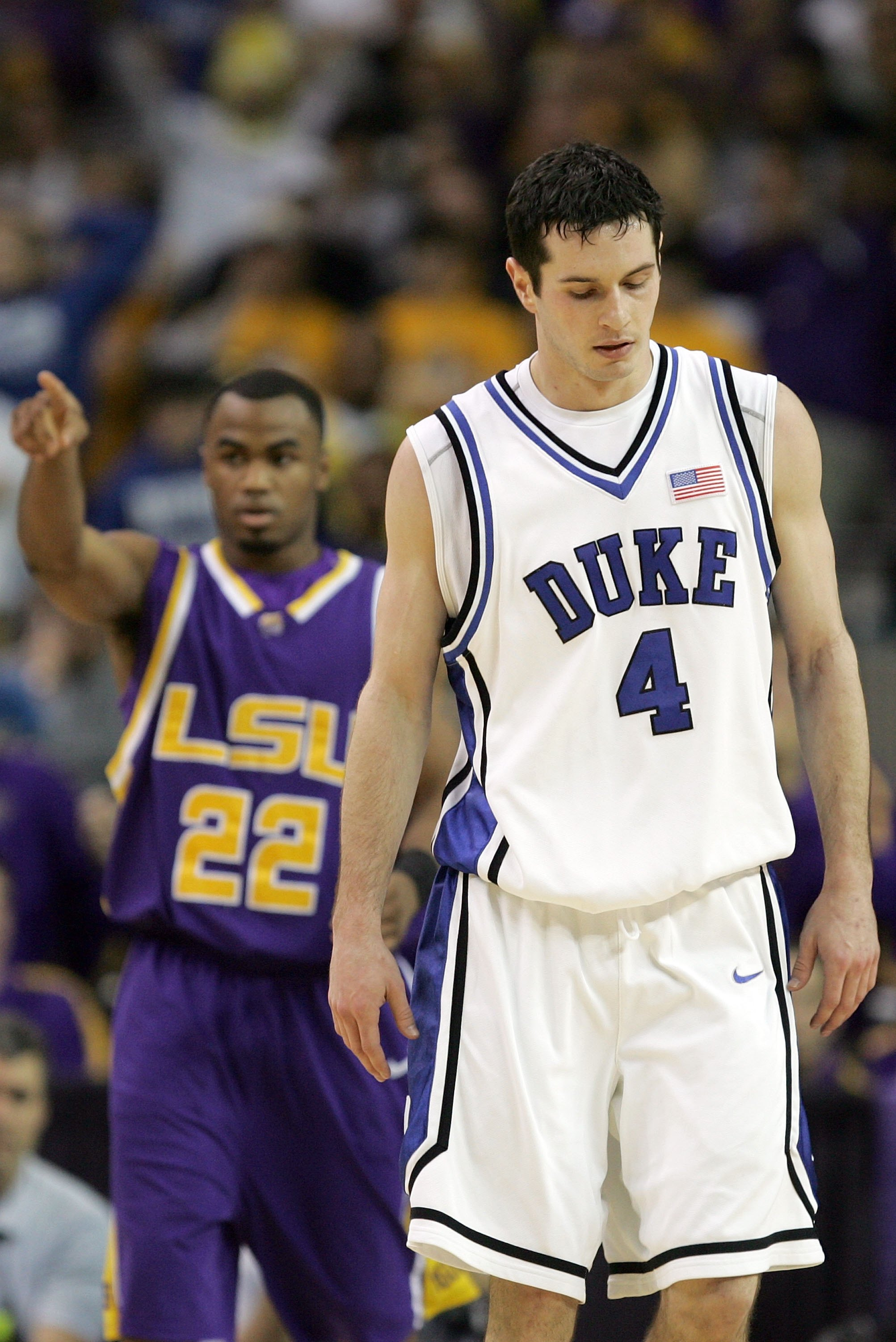 ATLANTA - MARCH 23:  J.J. Redick #4 of the Duke Blue Devils and Darrel Mitchell #22 of  the LSU Tigers walk down court during third round game of the 2006 NCAA Division I Men's Basketball Tournament Regional at the Georgia Dome on March 23, 2006 in Atlant