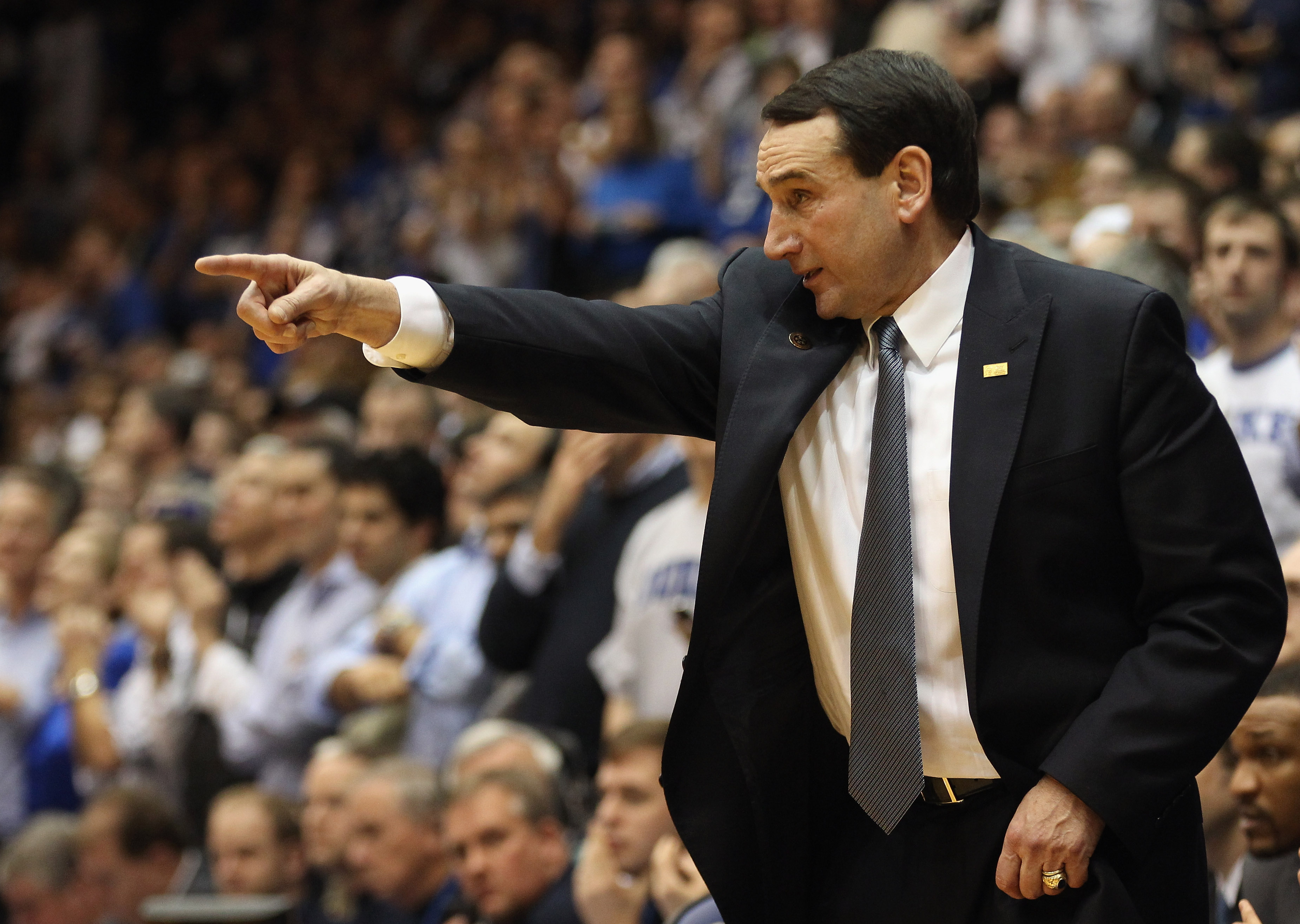 DURHAM, NC - FEBRUARY 09:  Head coach Mike Krzyzewski of the Duke Blue Devils yells to his team during their game against the North Carolina Tar Heels at Cameron Indoor Stadium on February 9, 2011 in Durham, North Carolina.  (Photo by Streeter Lecka/Getty