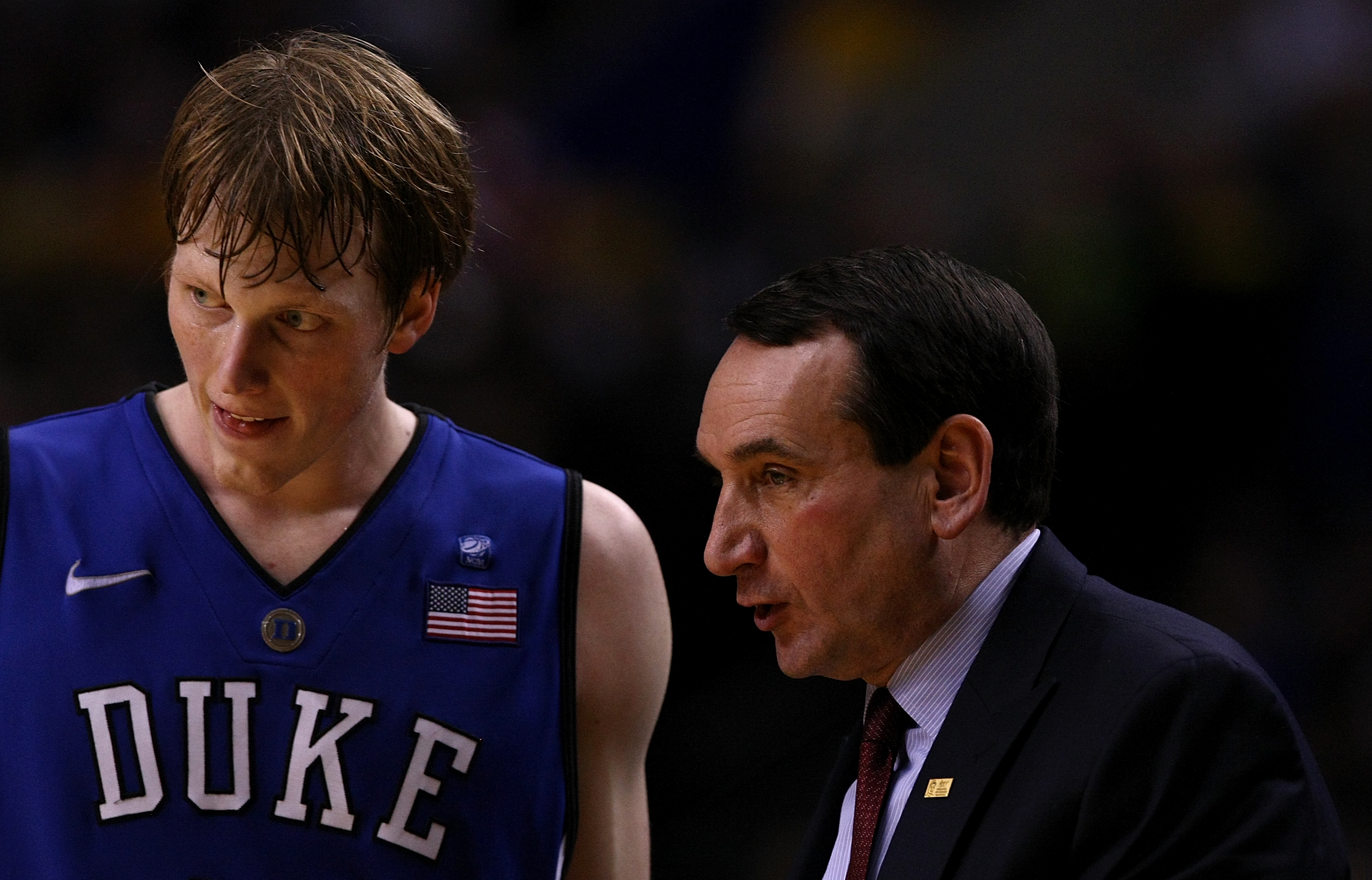 PORTLAND, OR - NOVEMBER 27:  Head Coach Mike Krzyzewski of the Duke Blue Devils talks Kyle Singler #12 against the Oregon Ducks on November 27, 2010 at the Rose Garden in Portland, Oregon.  (Photo by Jonathan Ferrey/Getty Images)