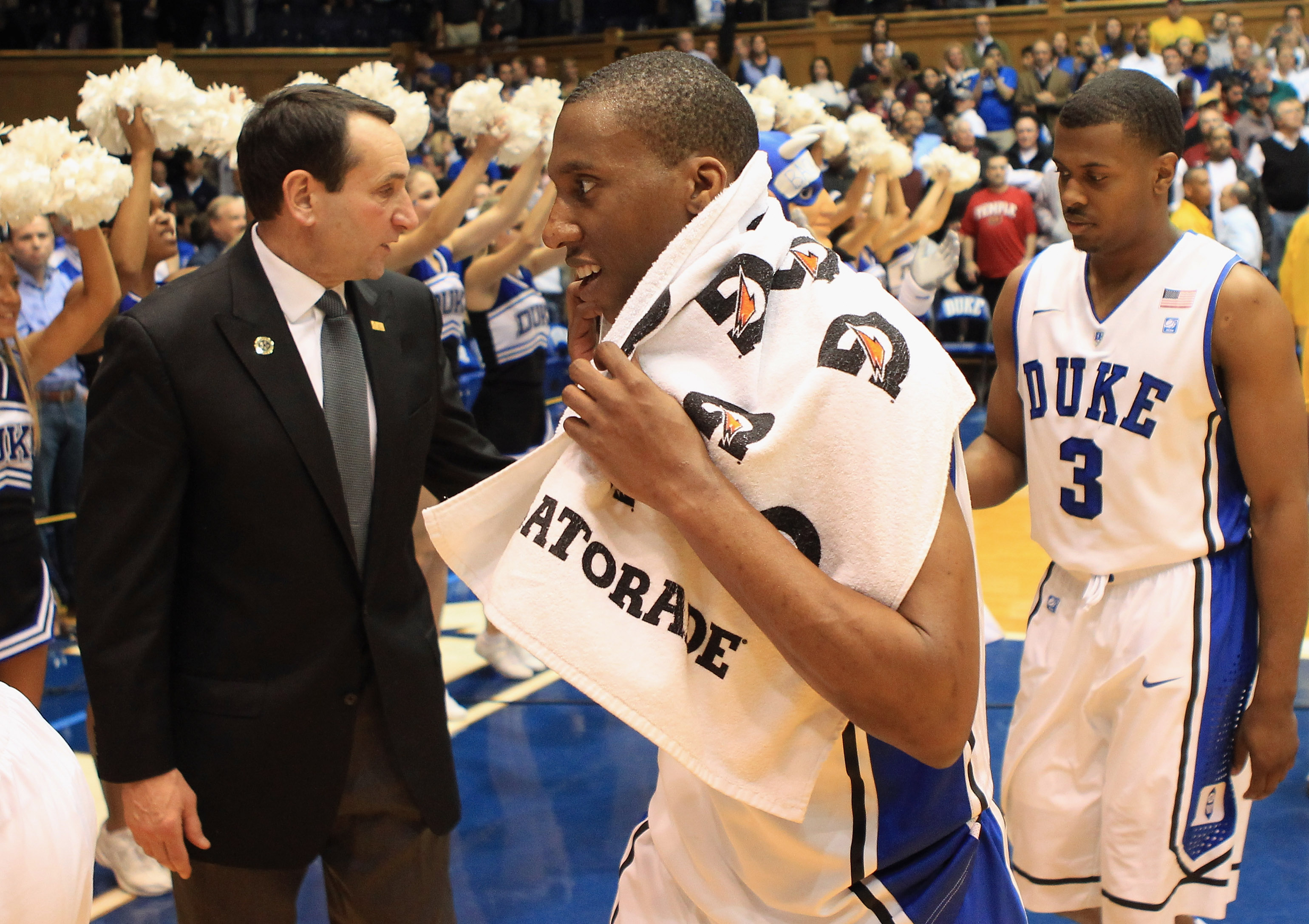 DURHAM, NC - FEBRUARY 23:  Head coach Mike Krzyzewski congratulates players Nolan Smith #2 and Tyler Thornton #3 of the Duke Blue Devils after their 78-61 victory over the Temple Owls at Cameron Indoor Stadium on February 23, 2011 in Durham, North Carolin