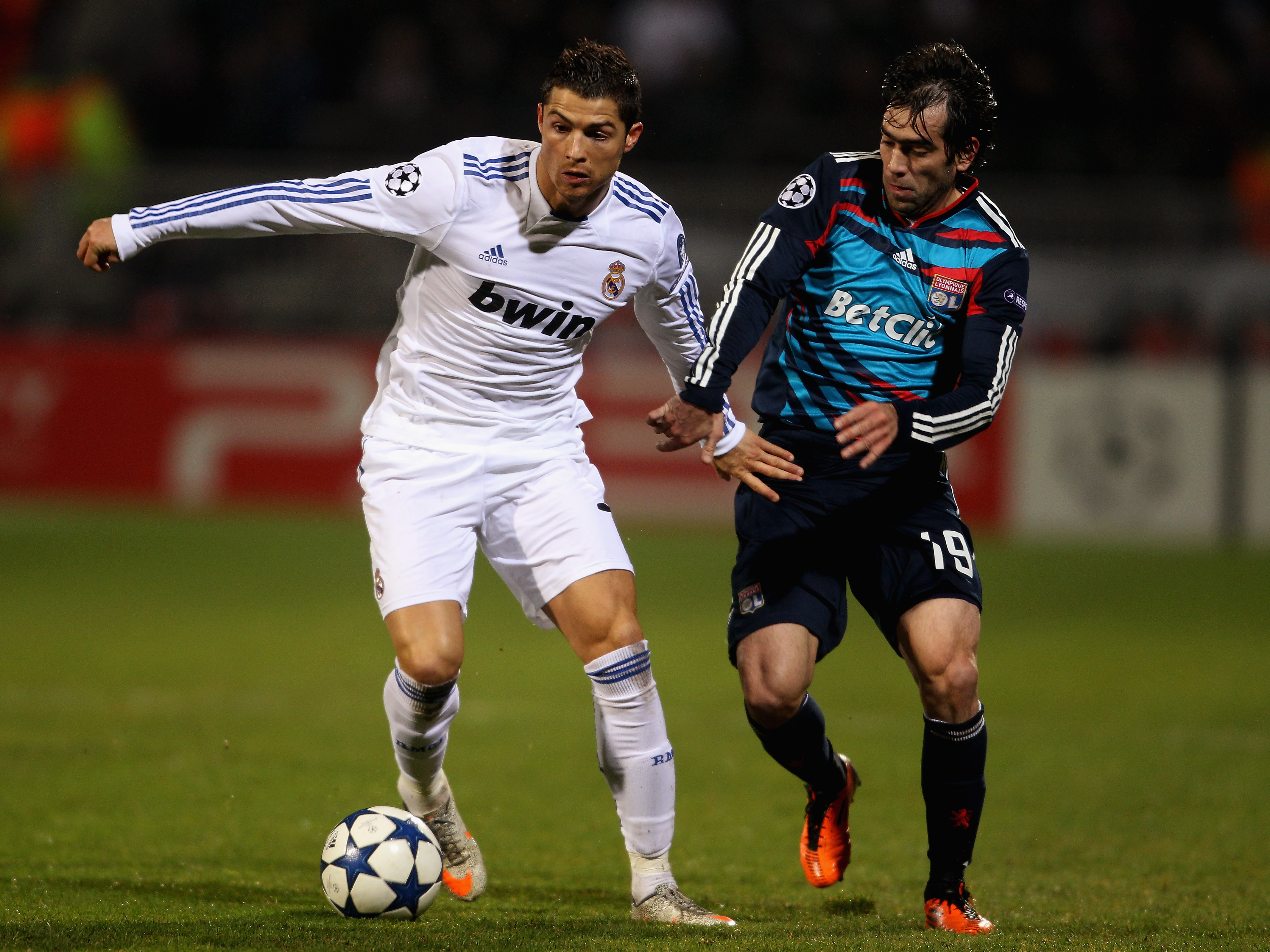 LYON, FRANCE - FEBRUARY 22:  Cristiano Ronaldo of Real Madrid (L) in action with Cesar Delgado of Lyon during the Champions League match between Lyon and Real Madrid at Stade Gerland on February 22, 2011 in Lyon, France.  (Photo by Scott Heavey/Getty Imag