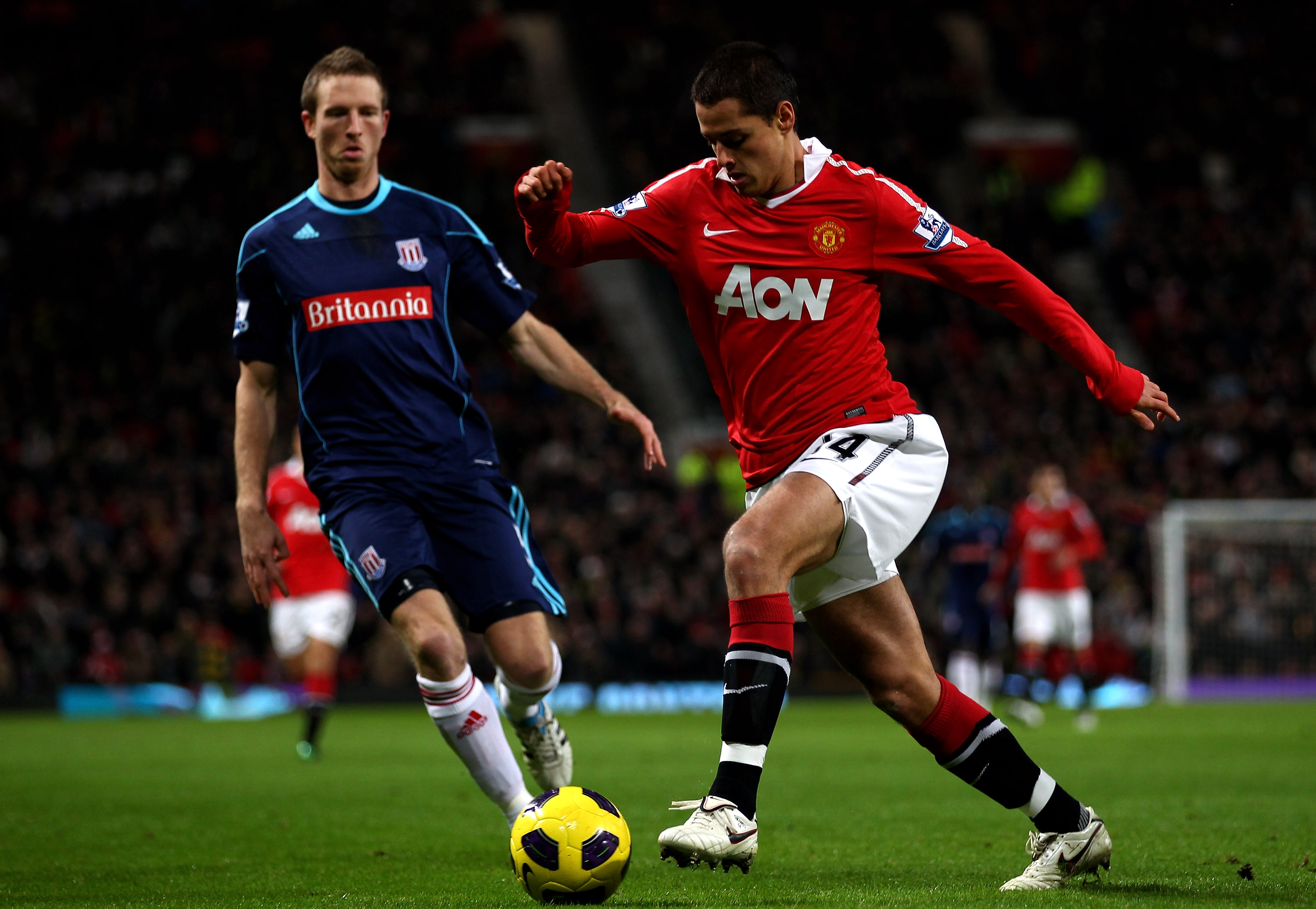 MANCHESTER, ENGLAND - JANUARY 04:  Javier Hernandez of Manchester United competes with Danny Collins of Stoke City during the Barclays Premier League match between Manchester United and Stoke City at Old Trafford on January 4, 2011 in Manchester, England.