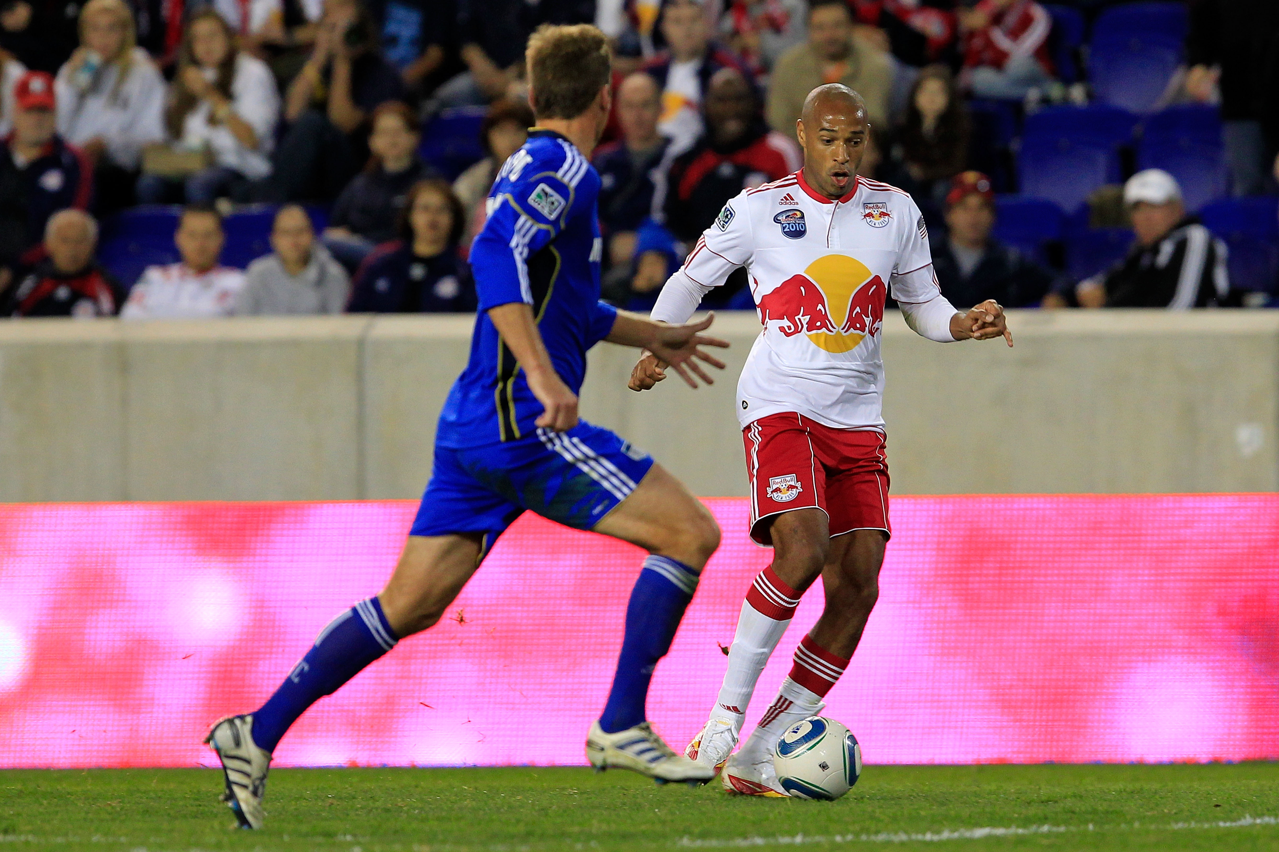 HARRISON, NJ - OCTOBER 02: Thierry Henry #14 of the New York Red Bulls controls the ball against Jimmy Conrad #12 of the Kansas City Wizards on October 2, 2010 at Red Bull Arena in Harrison, New Jersey. The Red Bulls defeated the Wizards 1-0. (Photo by Ch