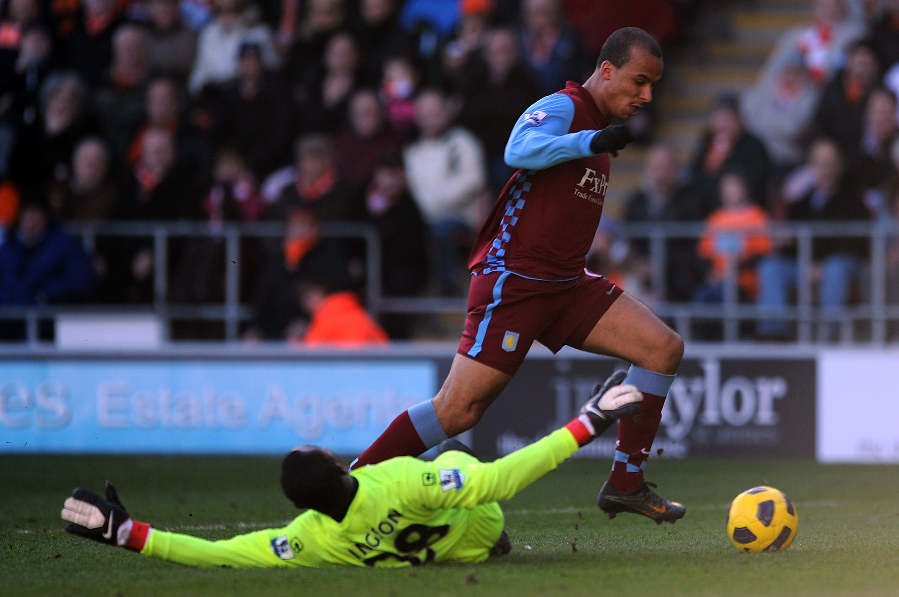 BLACKPOOL, ENGLAND - FEBRUARY 12:  Gabriel Agbonlahor of Aston Villa rounds Richard Kingson of Blackpool before scoring the opening goal during the Barclays Premier League match between Blackpool and Aston Villa at Bloomfield Road on February 12, 2011 in
