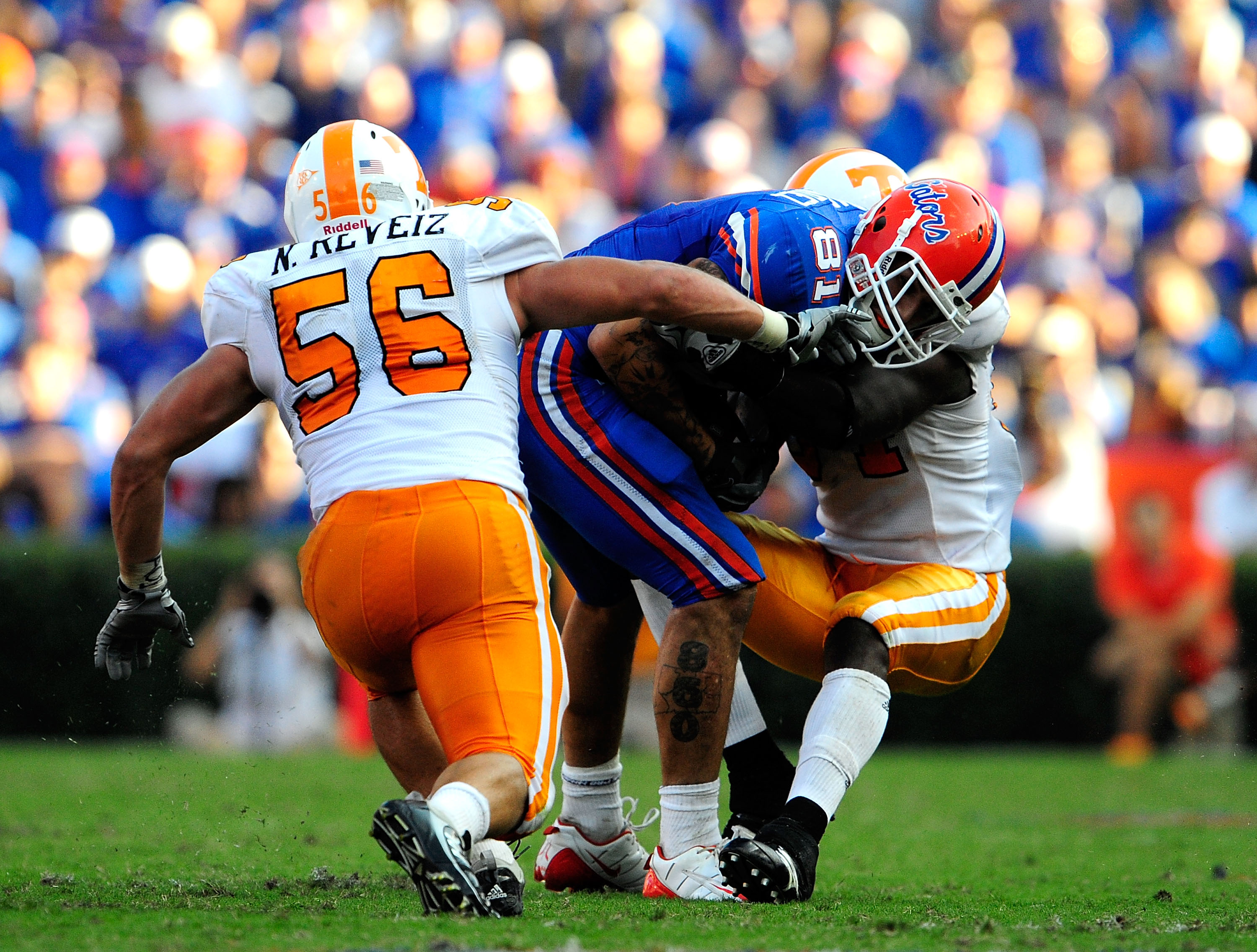 GAINESVILLE, FL - SEPTEMBER 19:  Aaron Hernandez #81 of the Florida Gators is tackled by Nick Reveiz #56 of the Tennessee Volunteers during the game at Ben Hill Griffin Stadium on September 19, 2009 in Gainesville, Florida.  (Photo by Sam Greenwood/Getty