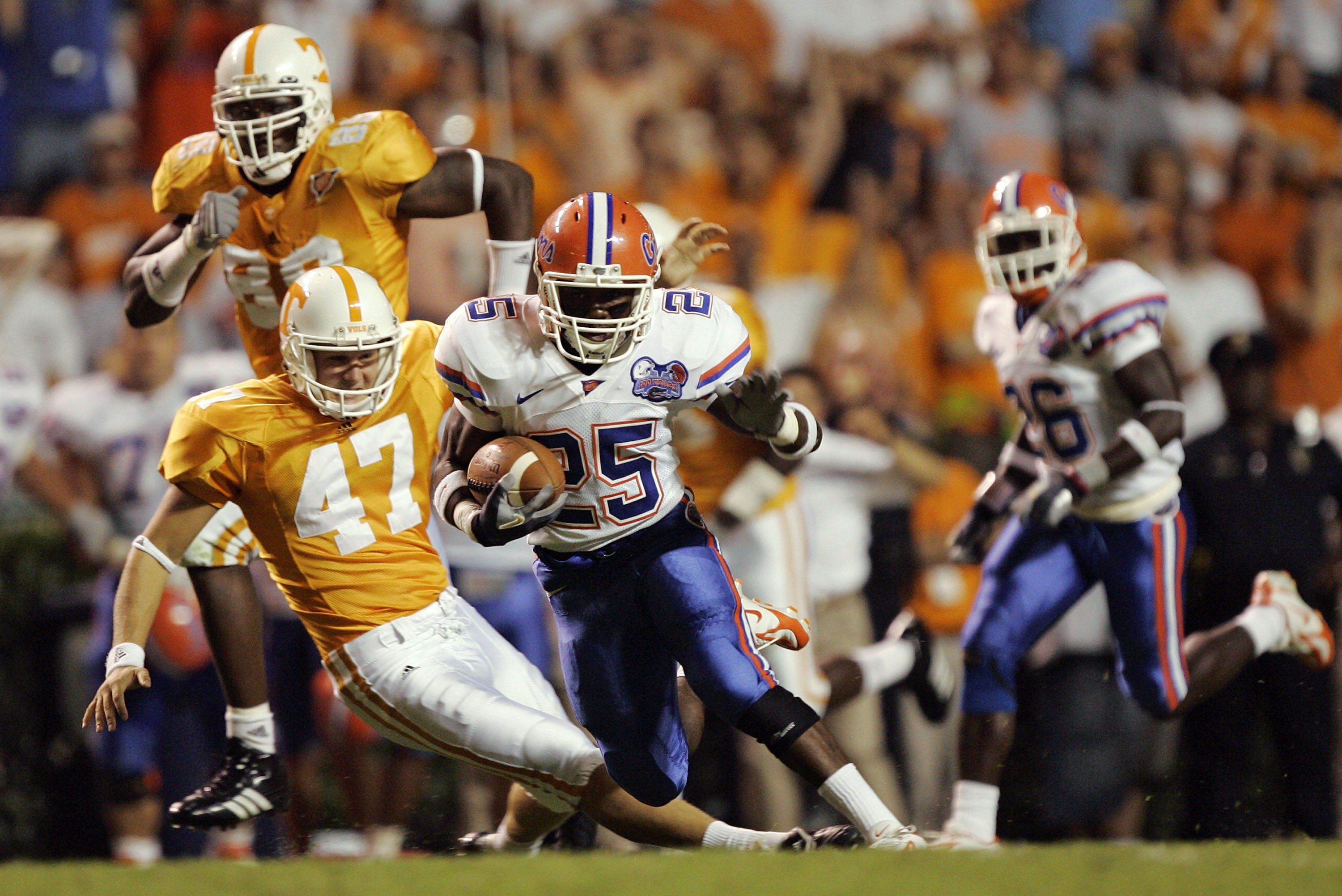 KNOXVILLE, TN - SEPTEMBER 16:  Punter Britton Colquitt #47 of the Tennessee Volunteers trips returner Brandon James #25 of the Florida Gators in the open field for a personal foul in the first quarter on September 16, 2006 at Neyland Stadium in Knoxville,