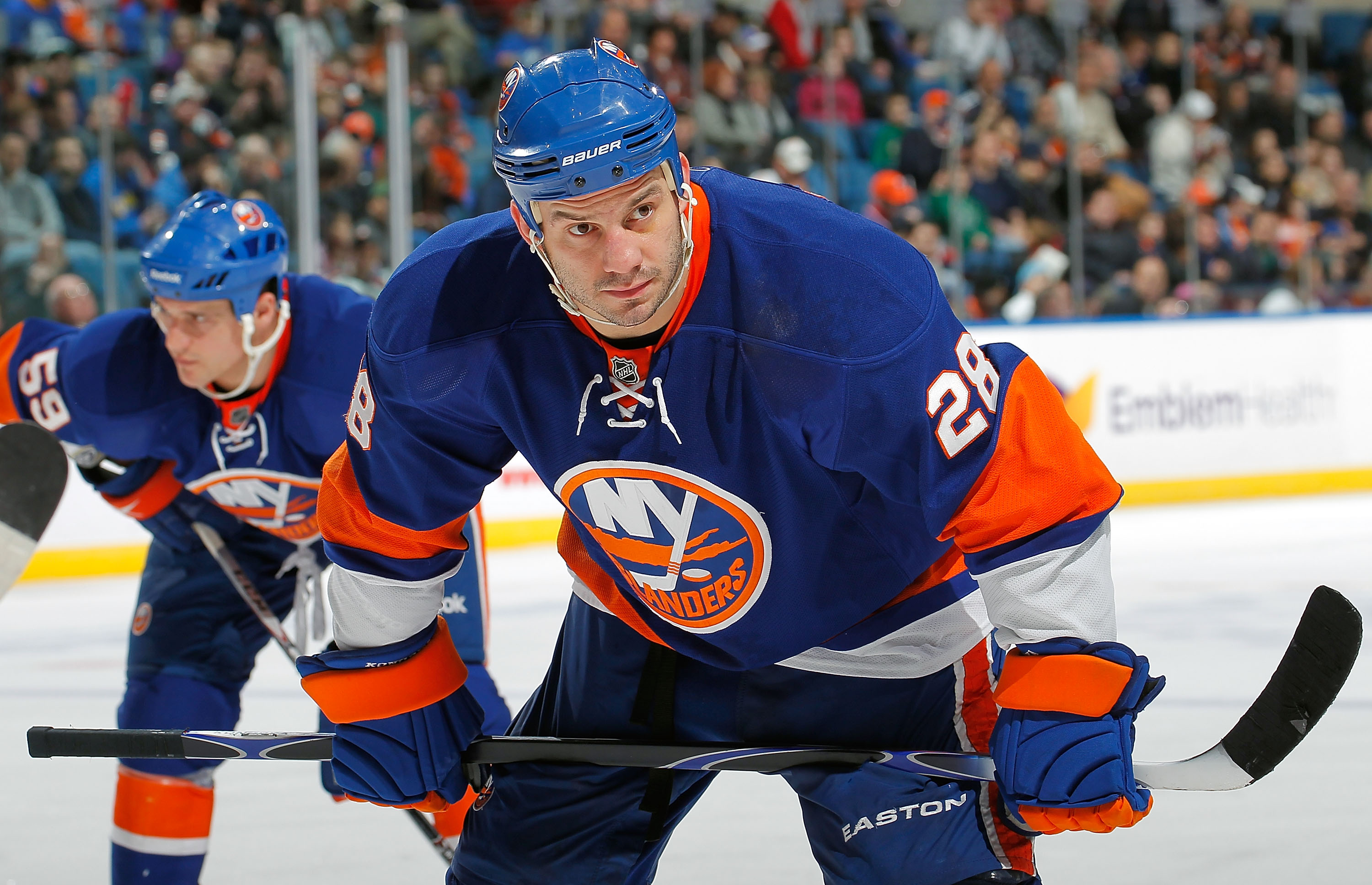 UNIONDALE, NY - FEBRUARY 21:  Zenon Konopka #28 of the New York Islanders waits for a faceoff during an NHL hockey game against the Florida Panthers at the Nassau Coliseum on February 21, 2011 in Uniondale, New York.  (Photo by Paul Bereswill/Getty Images