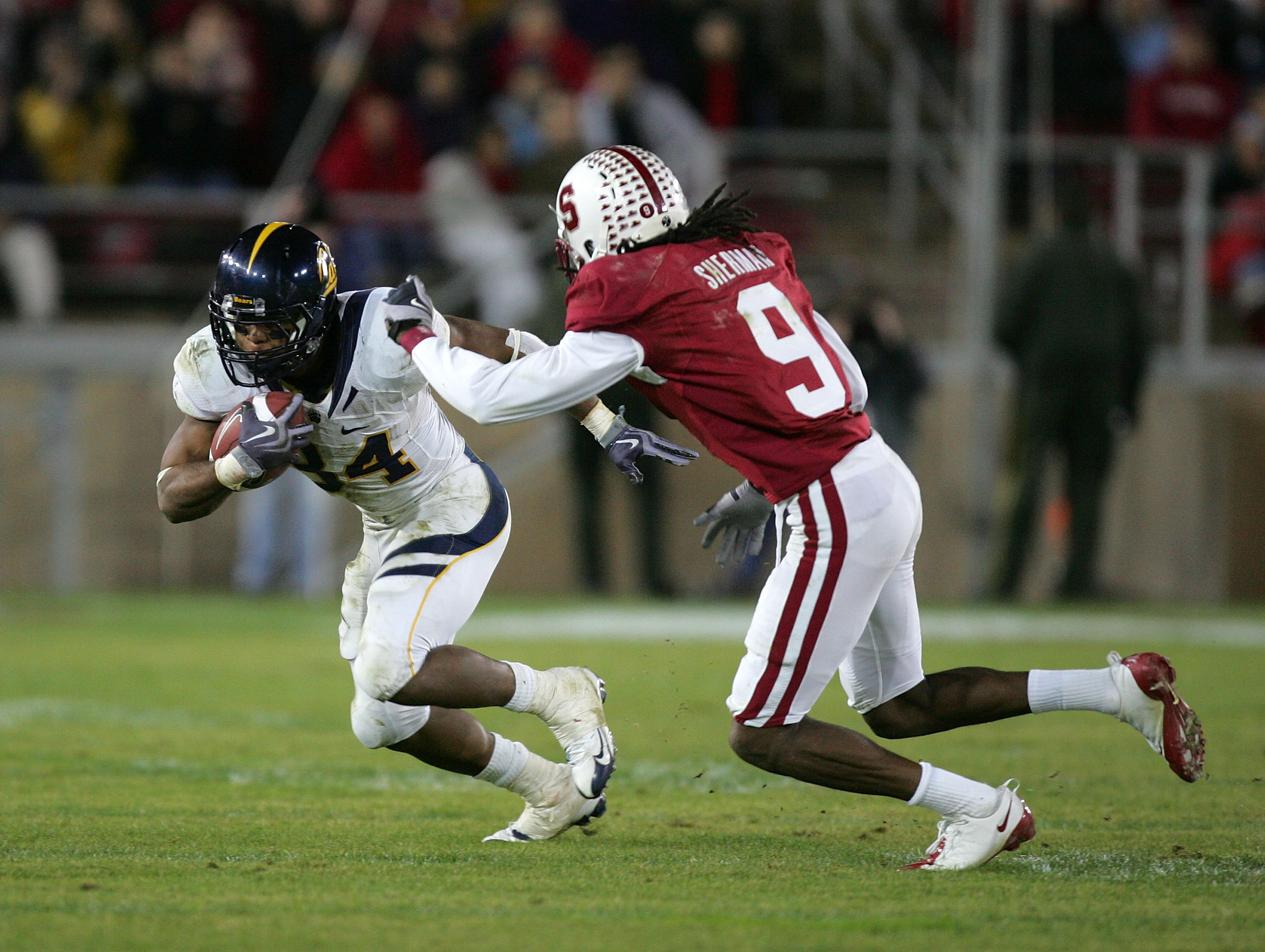 PALO ALTO, CA - NOVEMBER 21:  Shane Vereen #34 of the California Bears tries to run around Richard Sherman #9 of the Stanford Cardinal at Stanford Stadium on November 21, 2009 in Palo Alto, California.  (Photo by Ezra Shaw/Getty Images)