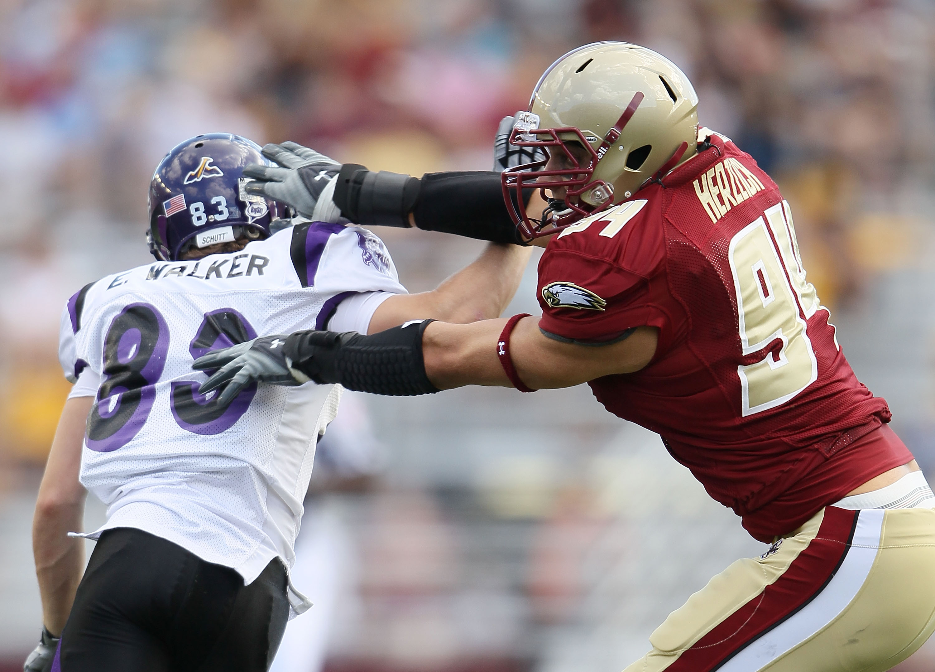 CHESTNUT HILL, MA - SEPTEMBER 04:  Mark Herzlich #94 of the Boston College Eagles blocks Erik Walker #83 of the Weber State Wildcats on September 4, 2010 at Alumni Stadium in Chestnut Hill, Massachusetts. Boston College defeated Weber State 38-20.  (Photo