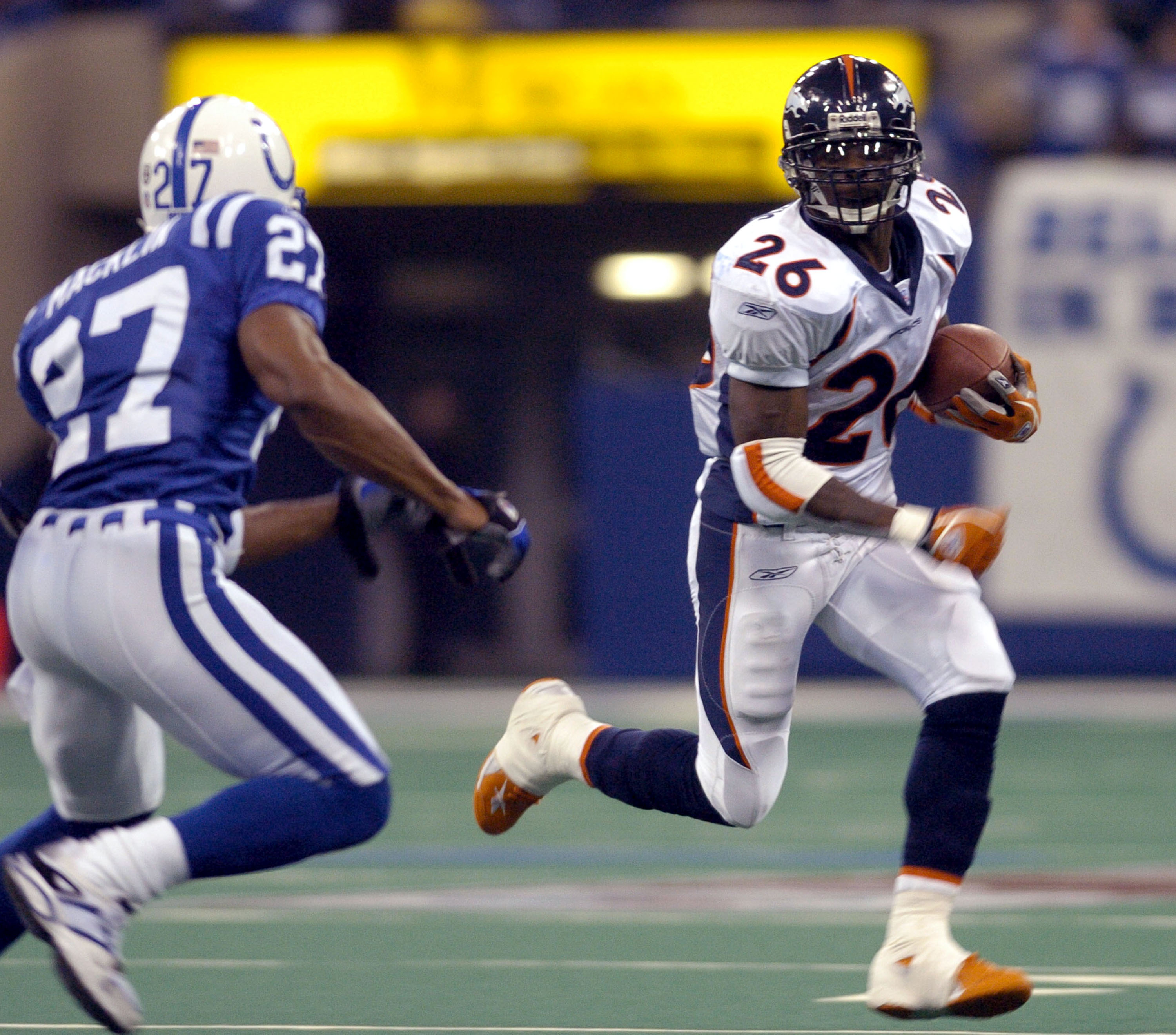 Denver Broncos running back Clinton Portis rushes for a gain at the RCA Dome, Indianapolis, Indiana, January 4, 2004 in an AFC wildcard playoff game.  (Photo by Al Messerschmidt/Getty Images)
