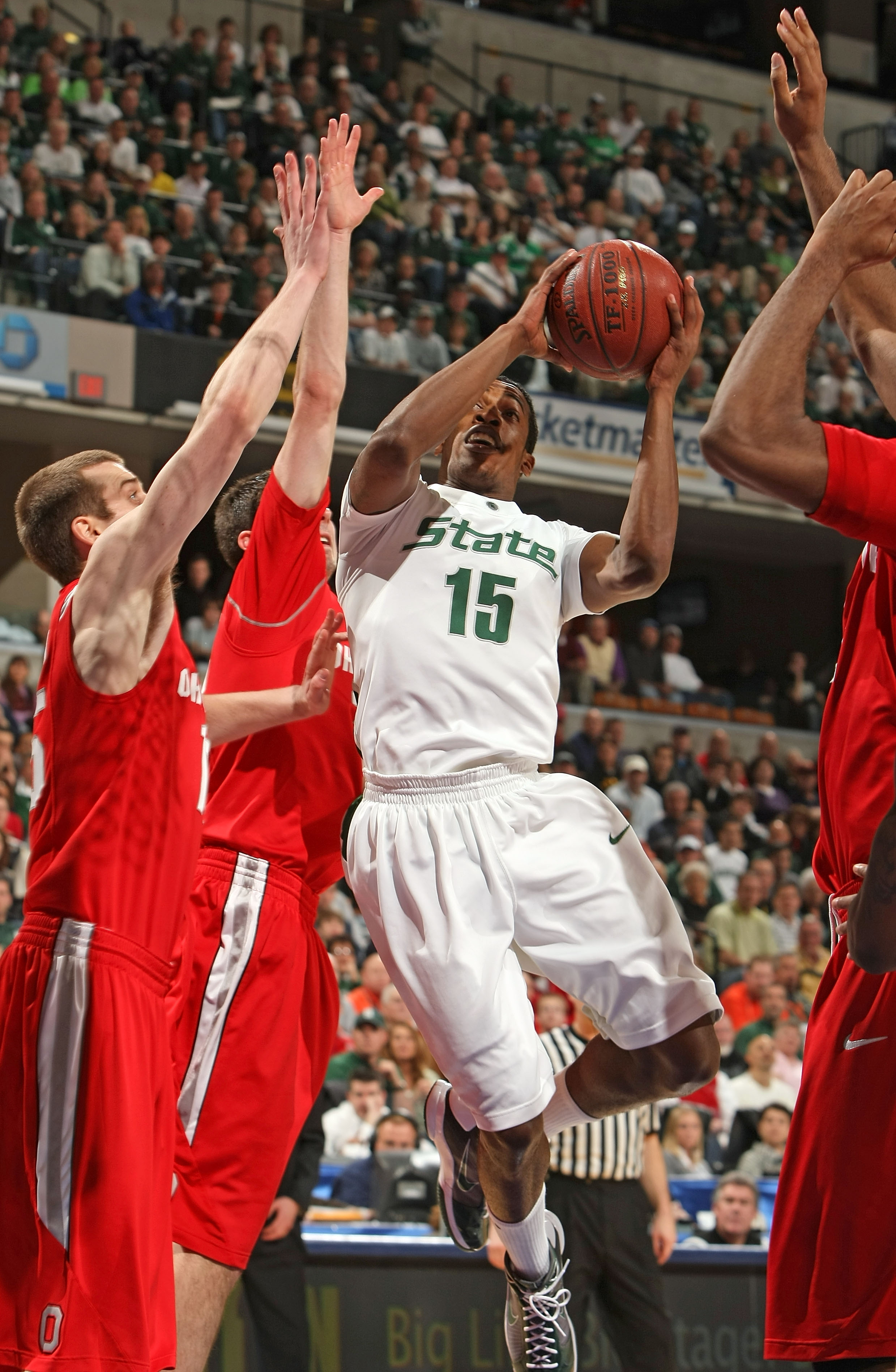 INDIANAPOLIS - MARCH 14:  Durrell Summers #15 of the Michigan State Spartans drives for a shot attempt against the Ohio State Buckeyes during their semifinal game of the Big Ten Men's Basketball Tournament at Conseco Fieldhouse on March 14, 2009 in Indian