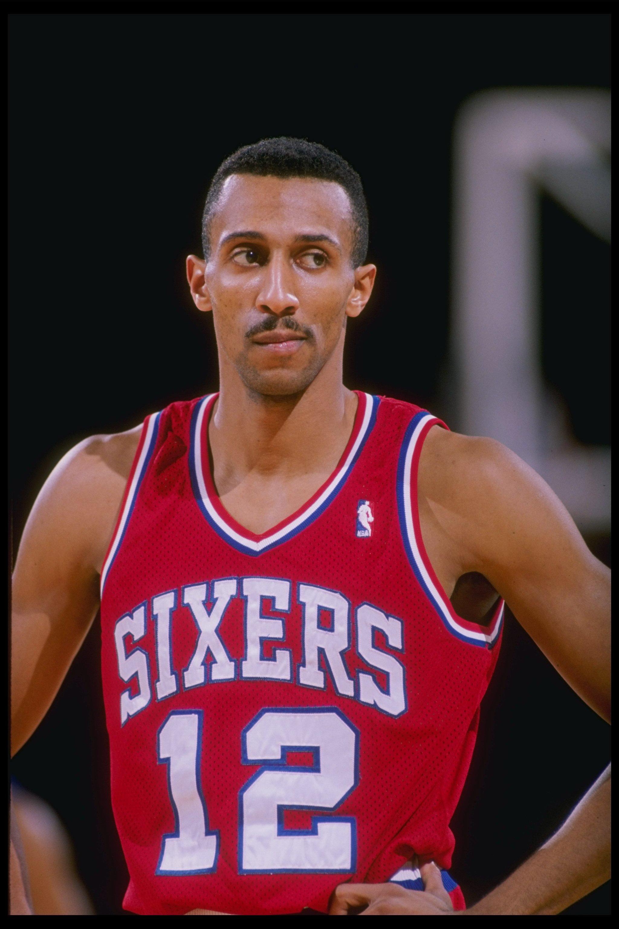 Guard Johnny Dawkins of the Philadelphia 76ers looks on.