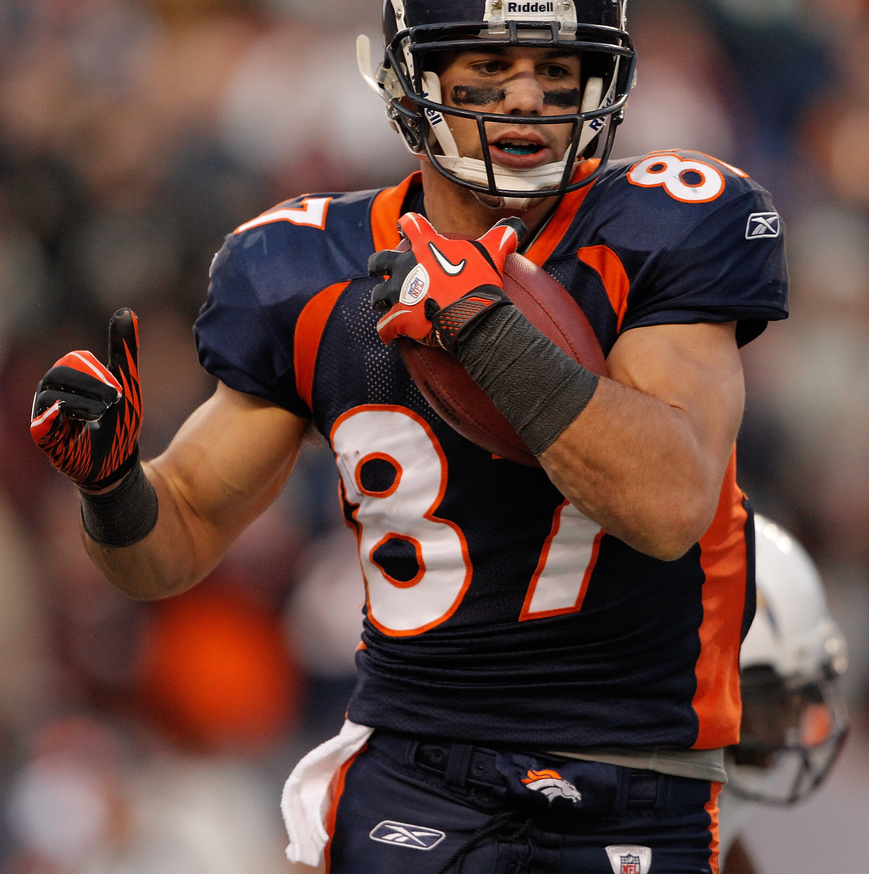 DENVER, CO - JANUARY 2:  Wide receiver Eric Decker #87 of the Denver Broncos scores a touchdown off a pass from Tim Tebow during the third quarter against the San Diego Chargers at INVESCO Field at Mile High on January 2, 2011 in Denver, Colorado. (Photo