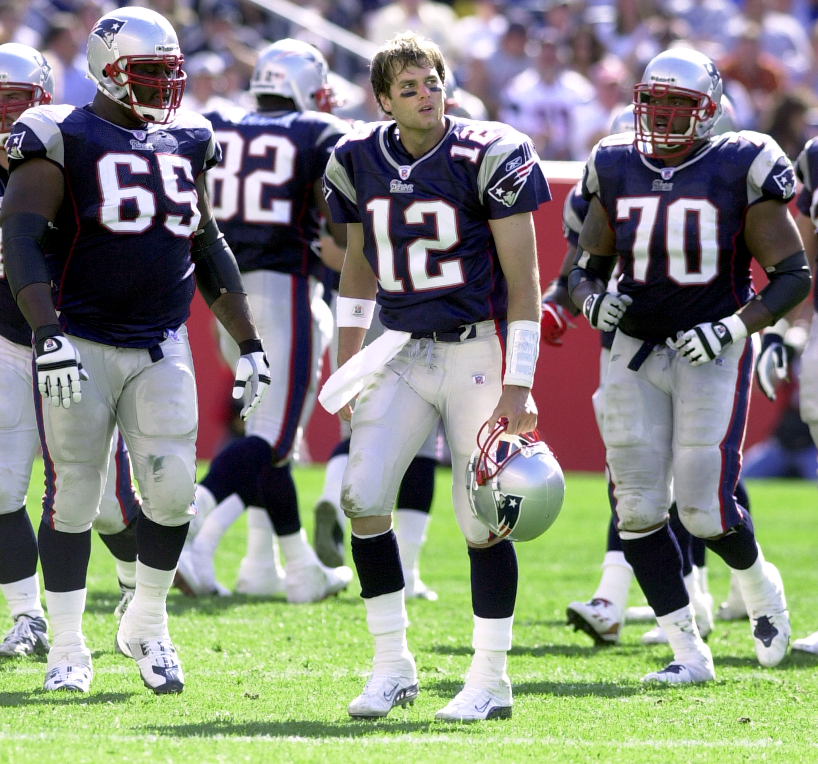 FOXBORO, MA - SEPTEMBER 21:  Quarterback Tom Brady #12 of the New England Patriots reacts to being sacked by the New York Jets during game action at Gillette Stadium September 21, 2003 in Foxboro, Massachusetts. This is the New England Patriots' home open
