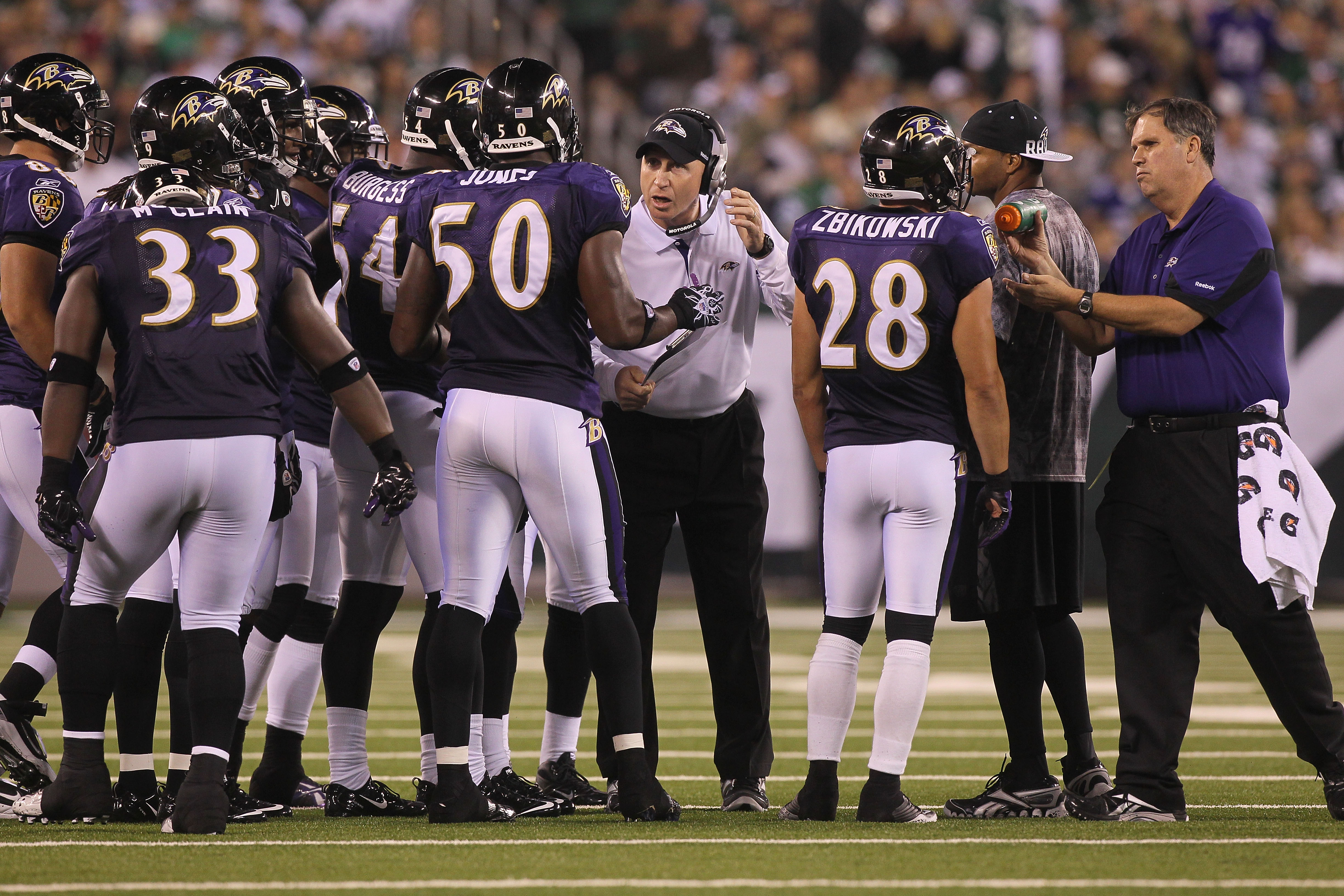 EAST RUTHERFORD, NJ - SEPTEMBER 13:  The Baltimore Ravens stand on the field against the New York Jets during their home opener at the New Meadowlands Stadium on September 13, 2010 in East Rutherford, New Jersey.  (Photo by Jim McIsaac/Getty Images)