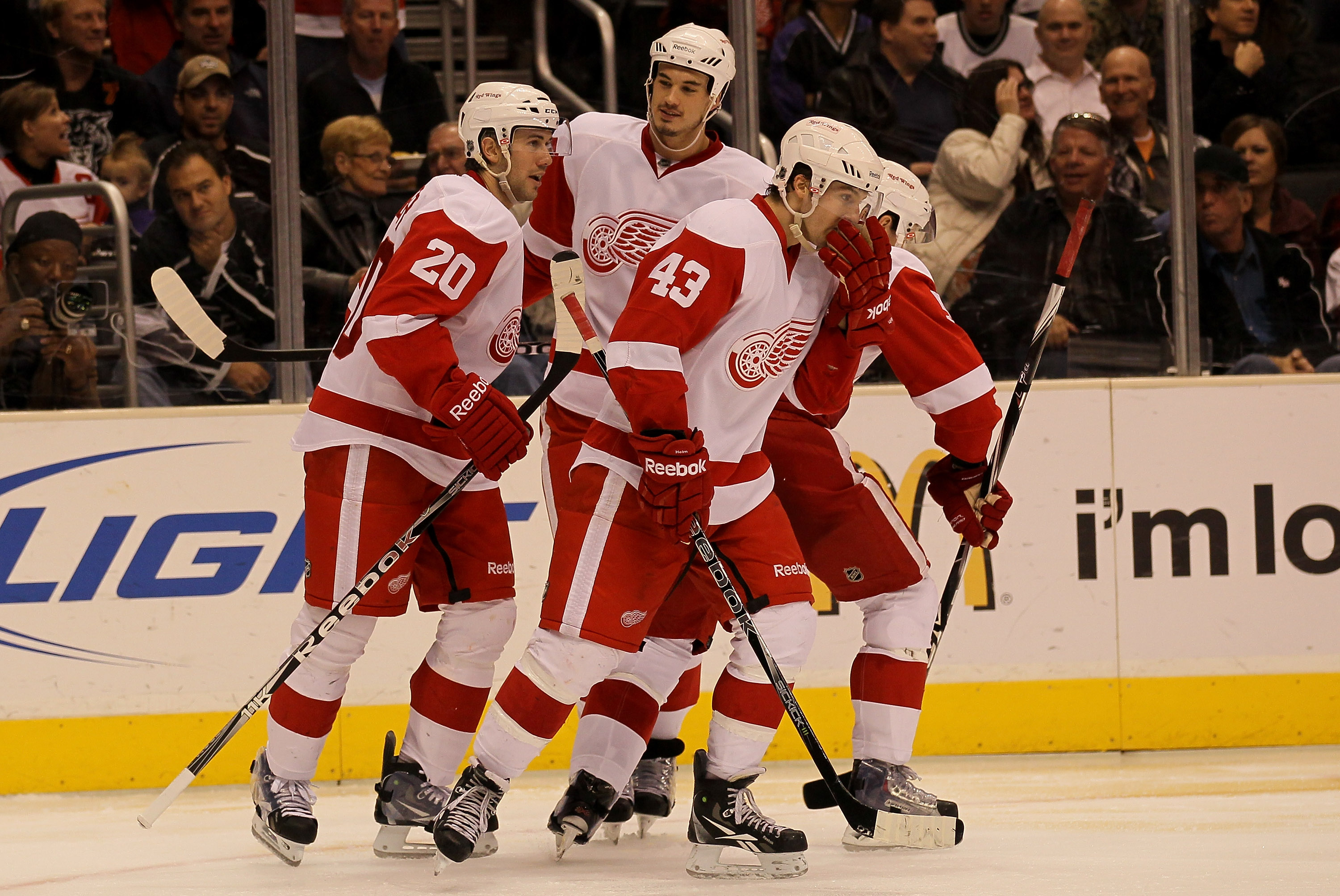 LOS ANGELES, CA - FEBRUARY 28: Drew Miller #20 of the Detroit Red Wings celebrates his third pereiod goal with Jonathan Ericsson #52 (C) and Darren Helm #43 against the Los Angeles Kings at Staples Center on February 28, 2011 in Los Angeles, California.