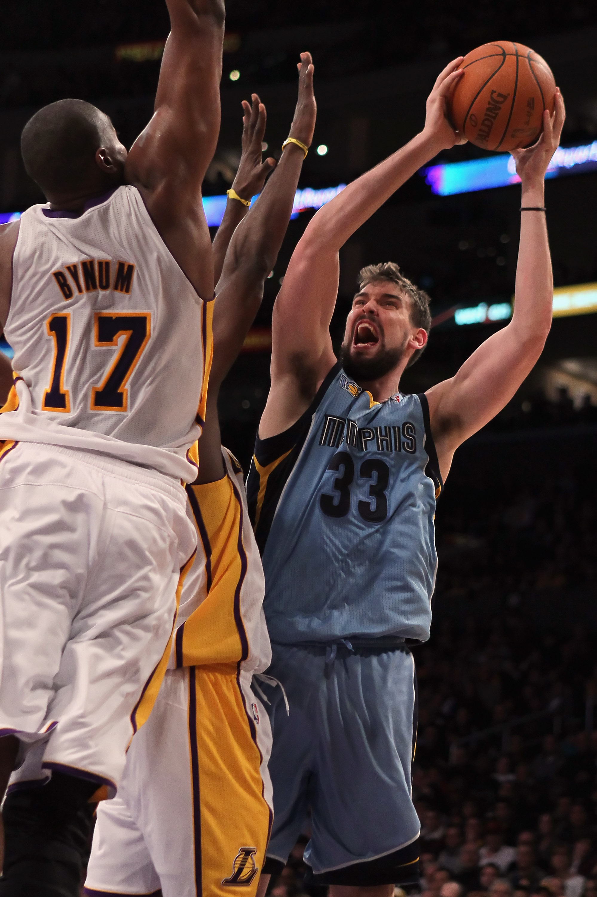 LOS ANGELES, CA - JANUARY 02:  Marc Gasol #33 of the Memphis Grizzlies drives to the basket while being defended by Andrew Bynum #17 of the Los Angeles Lakers during the first half at Staples Center on January 2, 2011 in Los Angeles, California. The Grizz