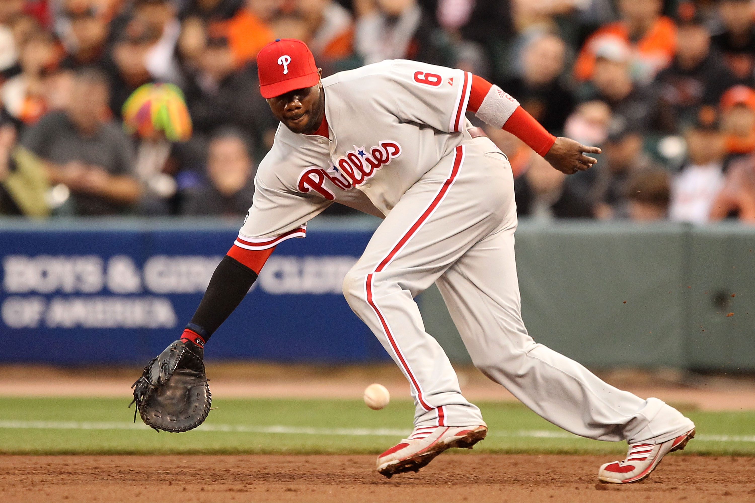 SAN FRANCISCO - OCTOBER 21:  Ryan Howard #6 of the Philadelphia Phillies fields a ball against the San Francisco Giants in Game Five of the NLCS during the 2010 MLB Playoffs at AT&T Park on October 21, 2010 in San Francisco, California.  (Photo by Ezra Sh