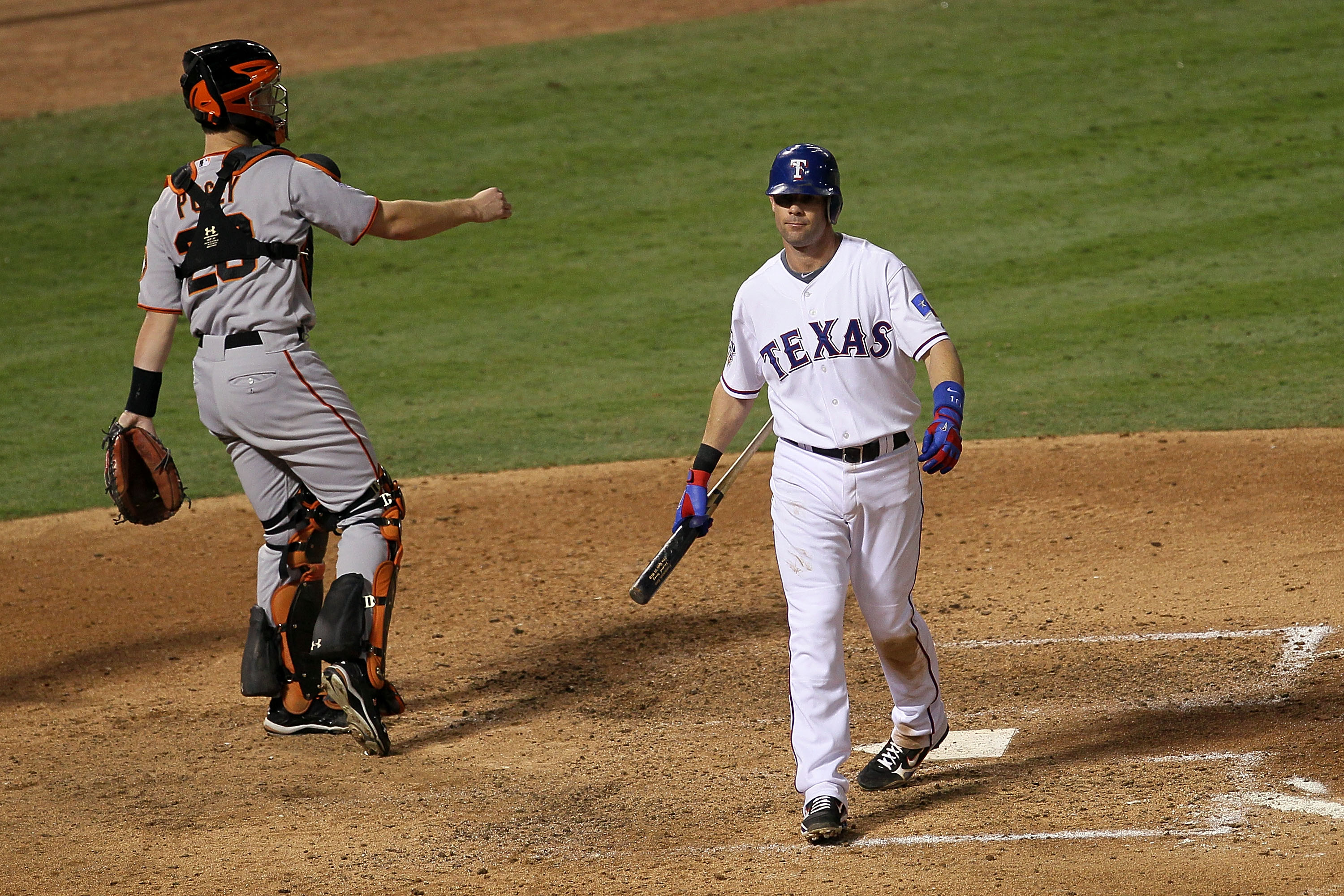ARLINGTON, TX - OCTOBER 31:  Michael Young #10 of the Texas Rangers reacts to striking out in the seventh inning against the San Francisco Giants as Buster Posey #55 throws to third in Game Four of the 2010 MLB World Series at Rangers Ballpark in Arlingto