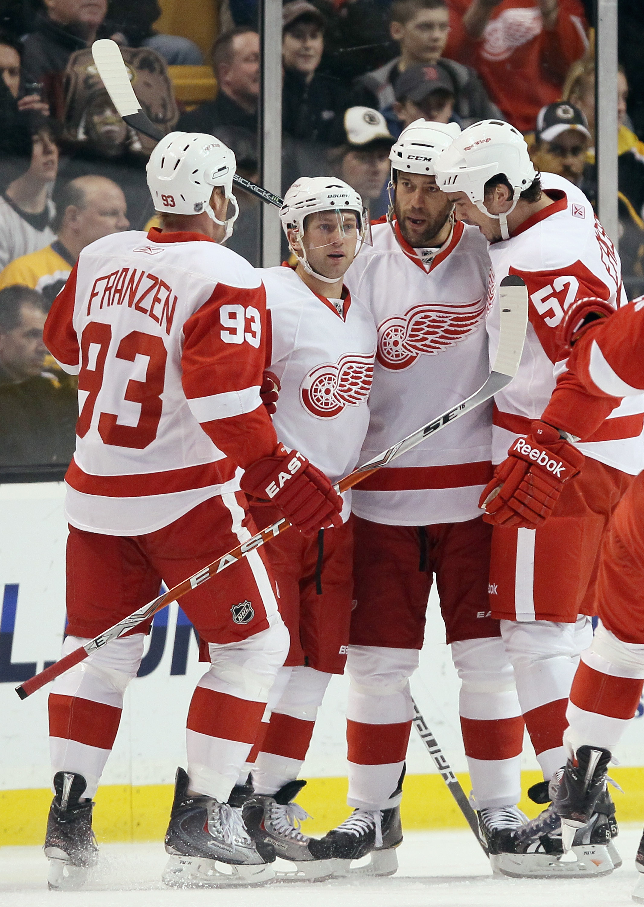 BOSTON, MA - FEBRUARY 11:  Todd Bertuzzi #44 of the Detroit Red Wings is congratulated by teammates Brian Rafalski #28,Johan Franzen #93 and Jonathan Ericsson #52 after Bertuzzi scored in the first period against the Boston Bruins on February 11, 2011 at
