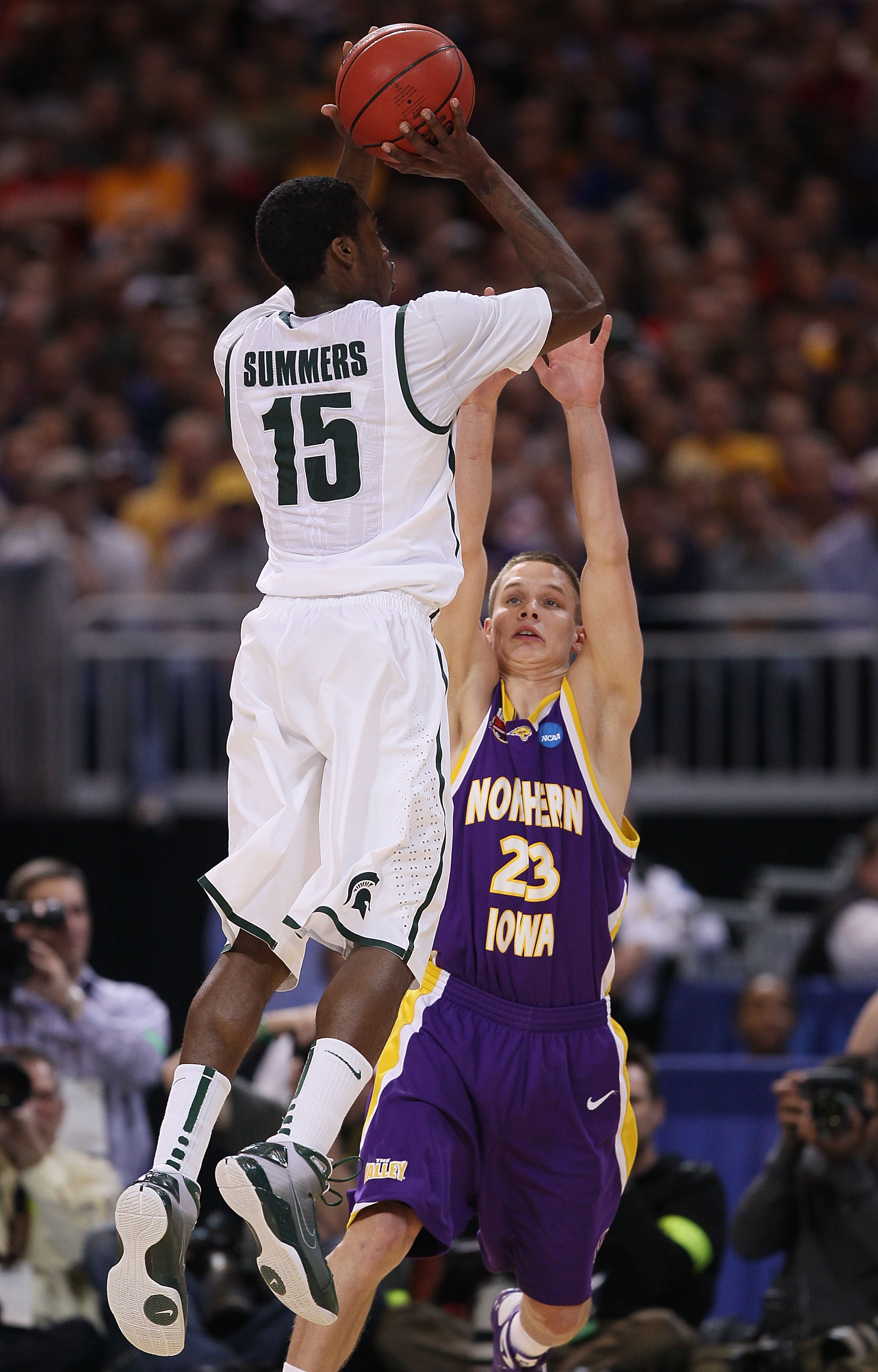 ST. LOUIS - MARCH 26:  Marc Sonnen #23 of the Northern Iowa Panthers tries to block a shot by Durrell Summers #15 of the Michigan State Spartans during the midwest regional semifinal of the 2010 NCAA men's basketball tournament at the Edward Jones Dome on