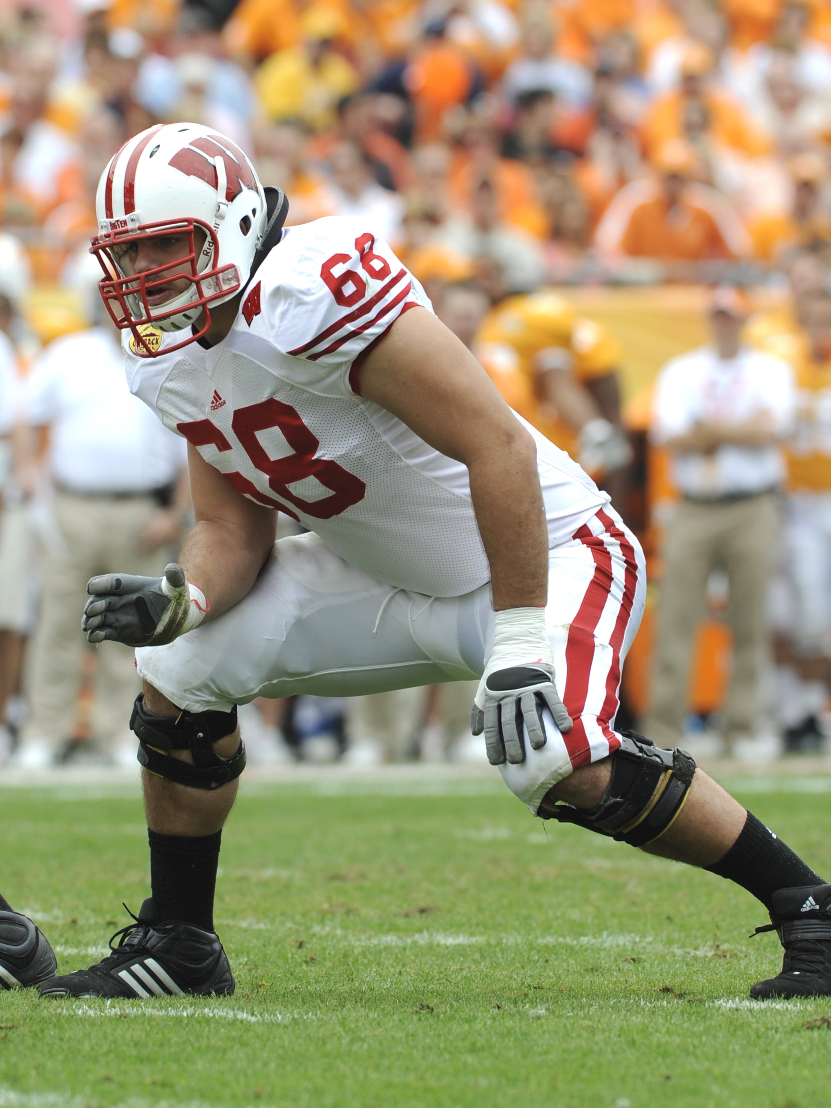 TAMPA, FL -  JANUARY 1: Lineman Gabe Carimi #68 of the Wisconsin Badgers sets to block  against the Tennessee Volunteers in the 2008 Outback Bowl at Raymond James Stadium on January 1, 2008 in Tampa, Florida.  The Volunteers won 21 - 17. (Photo by Al Mess