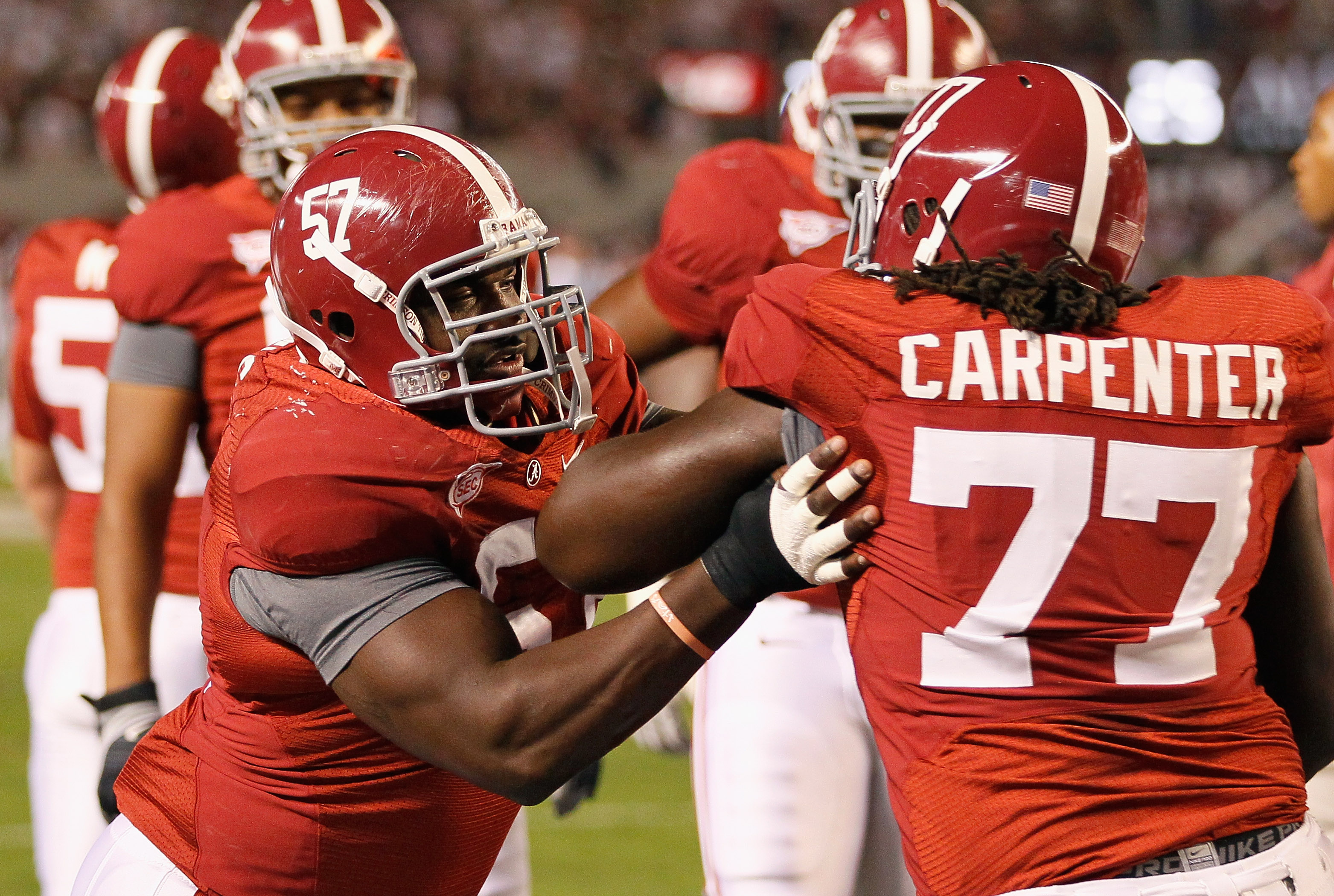 TUSCALOOSA, AL - OCTOBER 16:  Marcell Dareus #57 and James Carpenter #77 of the Alabama Crimson Tide against the Ole Miss Rebels at Bryant-Denny Stadium on October 16, 2010 in Tuscaloosa, Alabama.  (Photo by Kevin C. Cox/Getty Images)