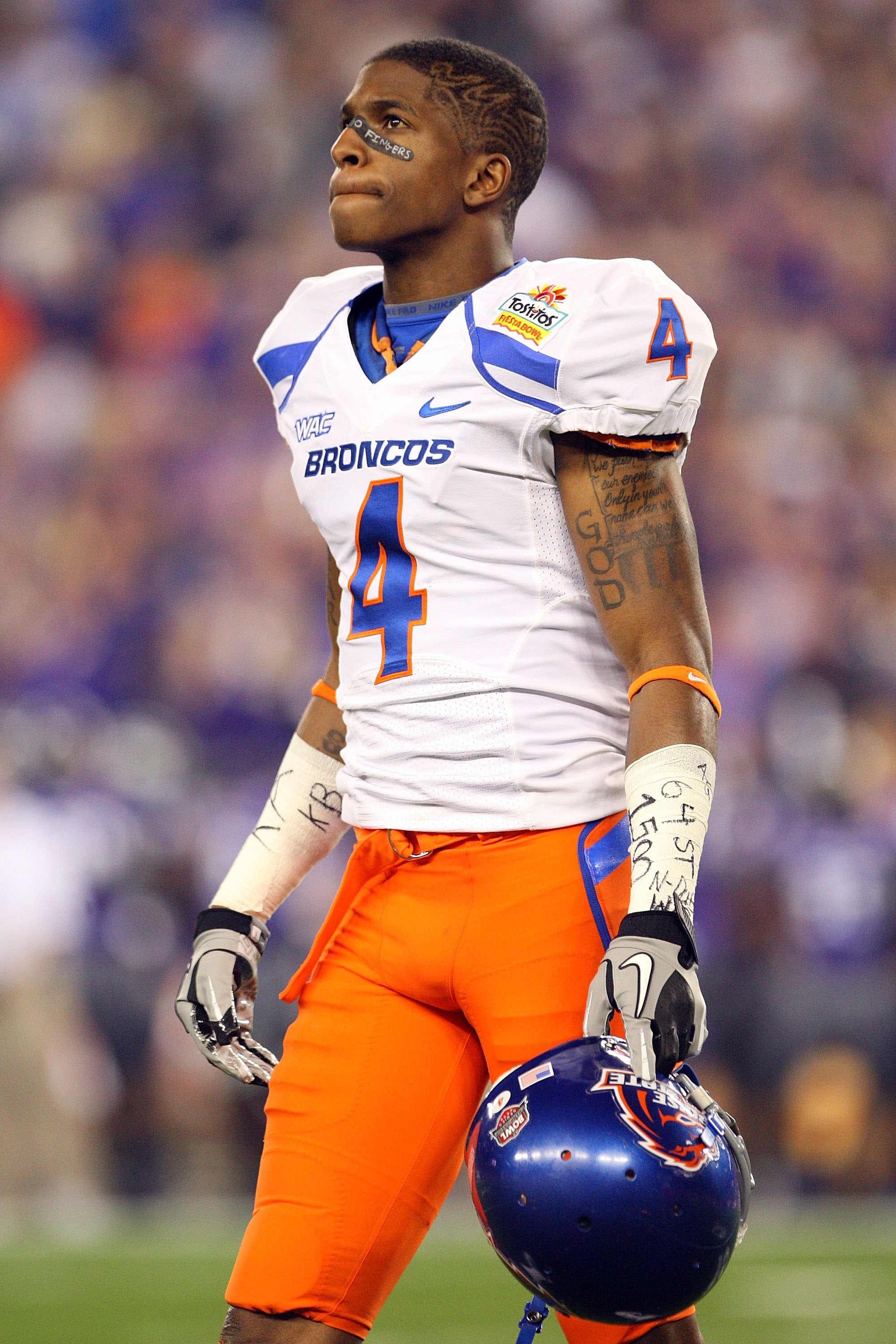 GLENDALE, AZ - JANUARY 04:  Titus Young #4 of the Boise State Broncos looks on against the TCU Horned Frogs during the Tostitos Fiesta Bowl at the Universtity of Phoenix Stadium on January 4, 2010 in Glendale, Arizona.  (Photo by Christian Petersen/Getty