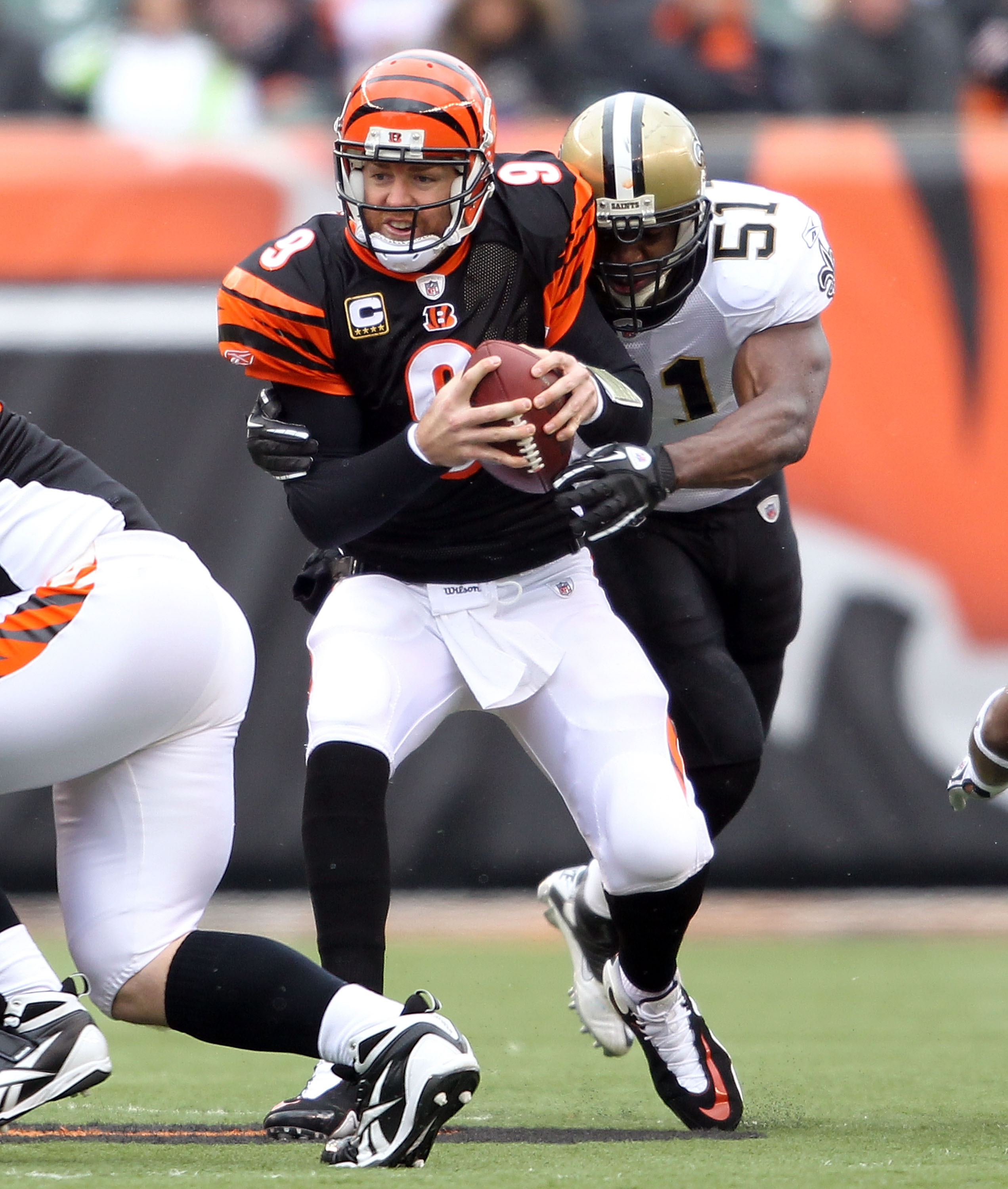 CINCINNATI, OH - DECEMBER 05:  Jonathan Vilma #51 of the New Orleans Saints sacks Carson Palmer #9 of the Cincinnati Bengals during the NFL game at Paul Brown Stadium on December 5, 2010 in Cincinnati, Ohio.  The Saints won 34-30.  (Photo by Andy Lyons/Ge