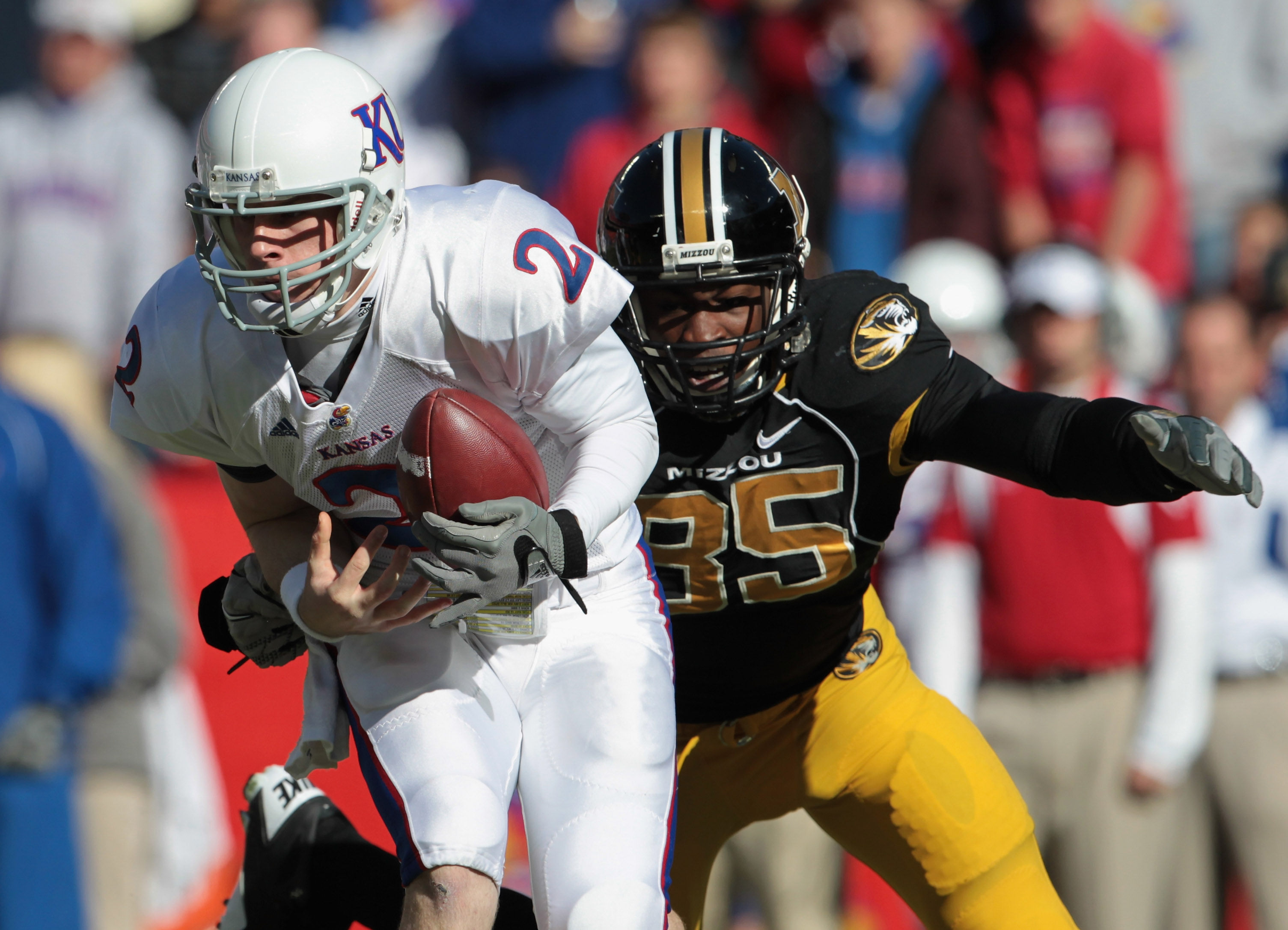 KANSAS CITY, MO - NOVEMBER 27:  Quarterback Jordan Webb #2 of the Kansas Jayhawks is sacked by Aldon Smith #85 of the Missouri Tigers during the game on November 27, 2010 at Arrowhead Stadium in Kansas City, Missouri.  (Photo by Jamie Squire/Getty Images)