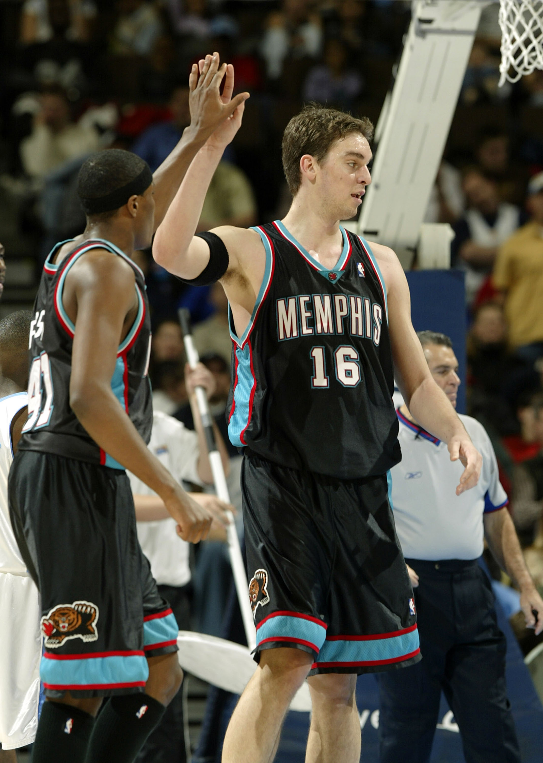 DENVER - DECEMBER 22:  Pau Gasol #16 of the Memphis Grizzlies high fives James Posey #41 after picking up a free throw against the Denver Nuggets in the first half December 22, 2003 at the Pepsi Center in Denver, Colorado.  NOTE TO USER:  User expressly a