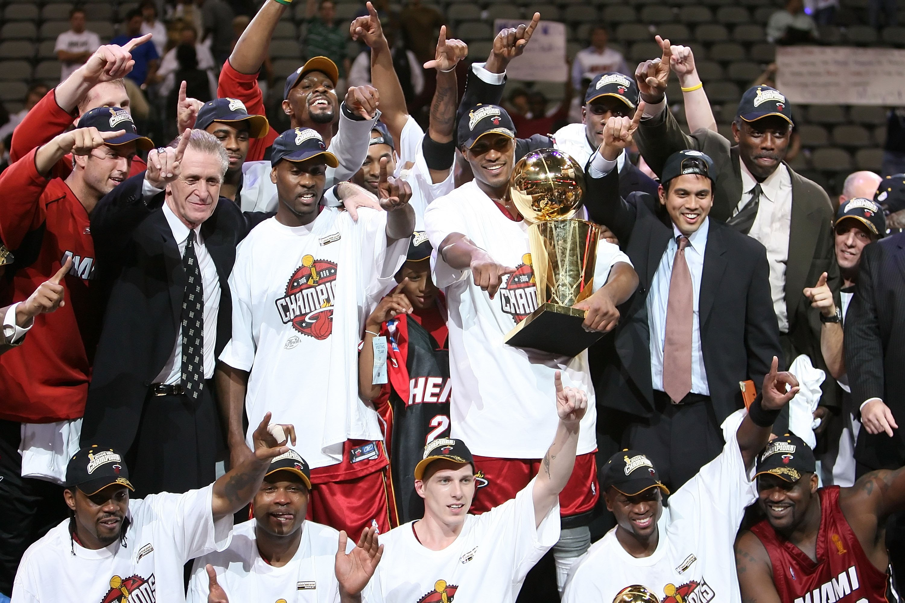 DALLAS - JUNE 20:  The Miami Heat celebrate as they receive the Larry O'Brien trophy after the Heat defeated the Dallas Mavericks in game six of the 2006 NBA Finals on June 20, 2006 at American Airlines Center in Dallas, Texas.  The Heat won 95-92 and win