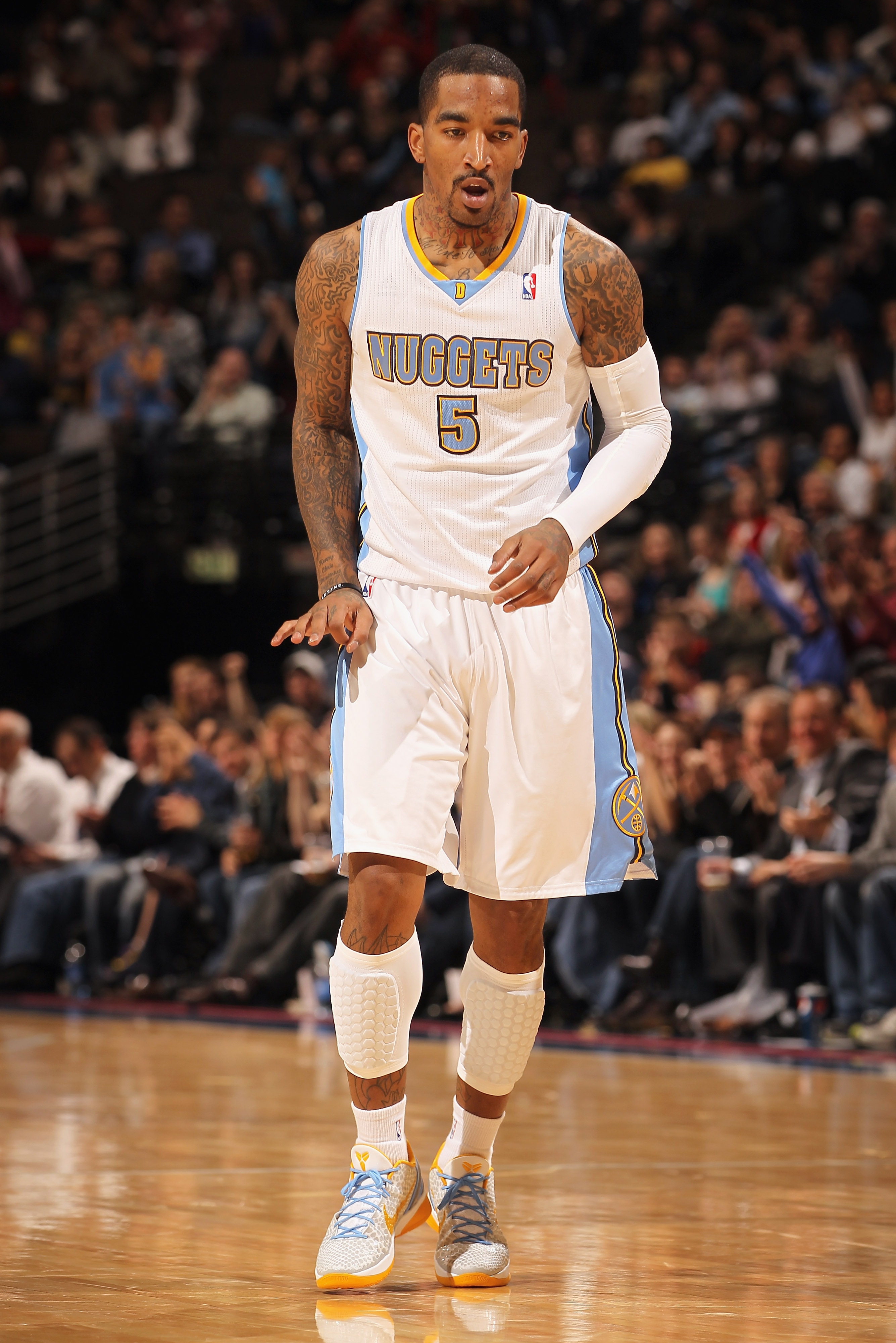 DENVER, CO - FEBRUARY 28:  J.R. Smith #5 of the Denver Nuggets gestures after scoring a three point basket against the Atlanta Hawks during NBA action at the Pepsi Center on February 28, 2011 in Denver, Colorado. The Nuggets deafeated the Hawks 100-90. NO