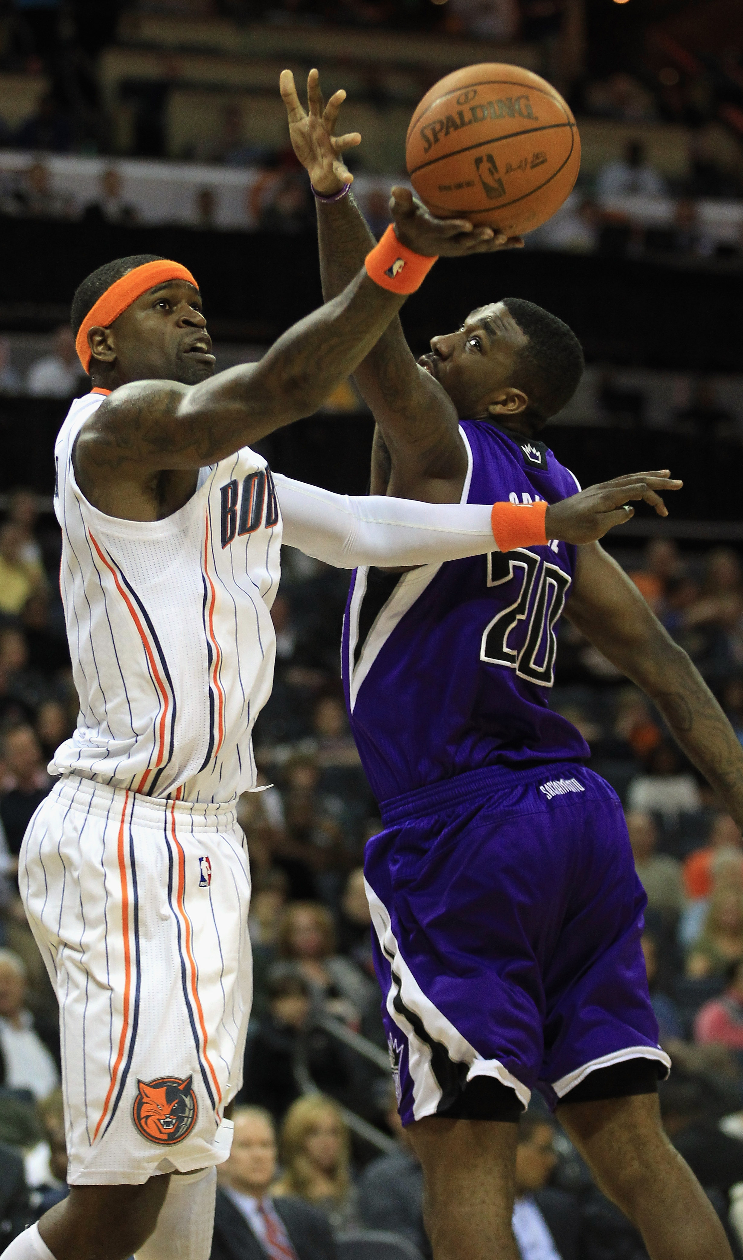 CHARLOTTE, NC - FEBRUARY 25:  Donte Greene #20 of the Sacramento Kings tries to stop Stephen Jackson #1 of the Charlotte Bobcats during their game at Time Warner Cable Arena on February 25, 2011 in Charlotte, North Carolina. NOTE TO USER: User expressly a