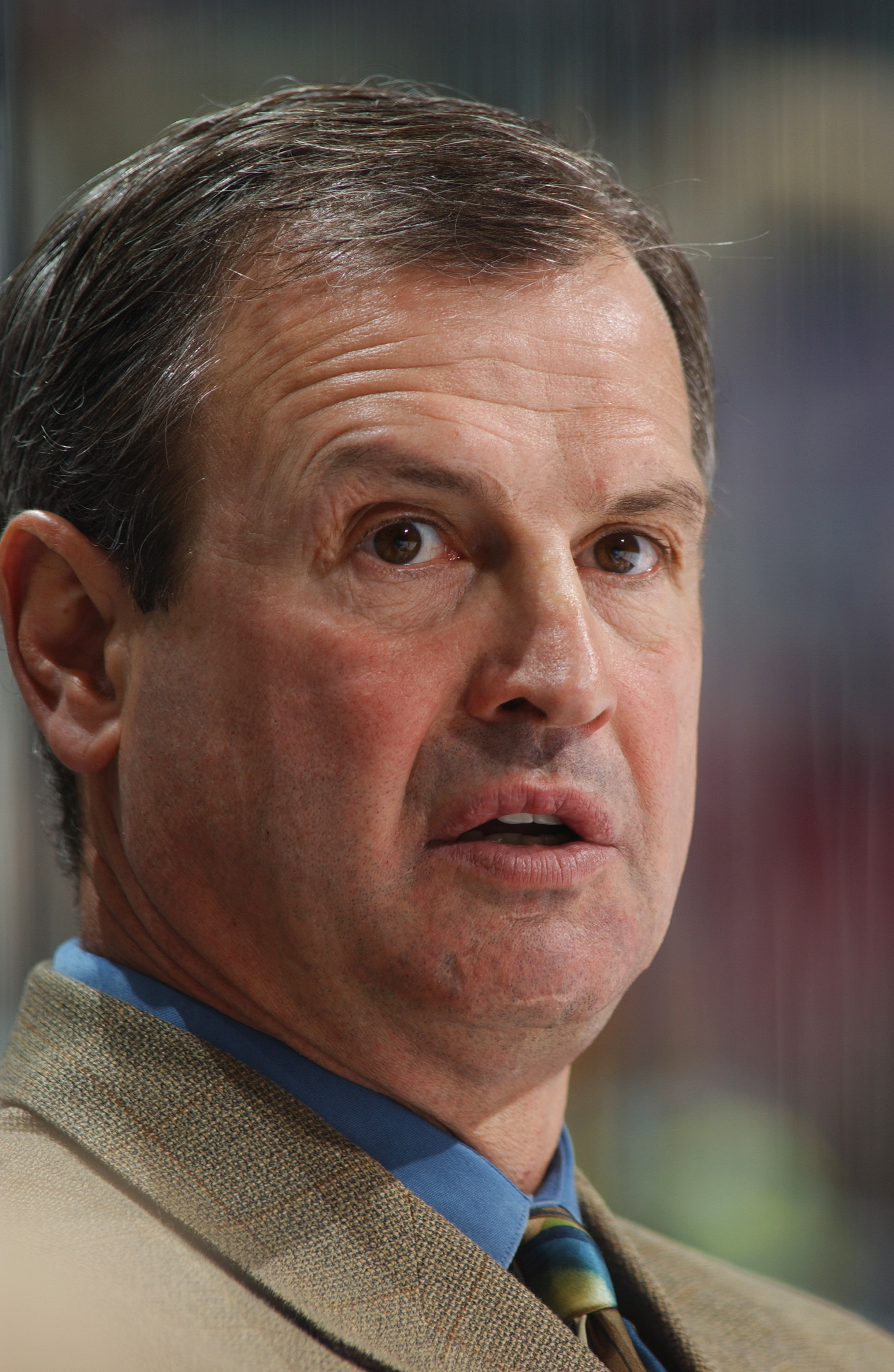 ATLANTA - OCTOBER 18:  Head coach Brian Sutter of the Chicago Blackhawks watches the game against his Atlanta Thrashers at Philips Arena on October 18, 2003 in Atlanta, Georgia.  The Thrashers defeated the Blackhawks 7-2.  (Photo by Scott Cunningham/Getty