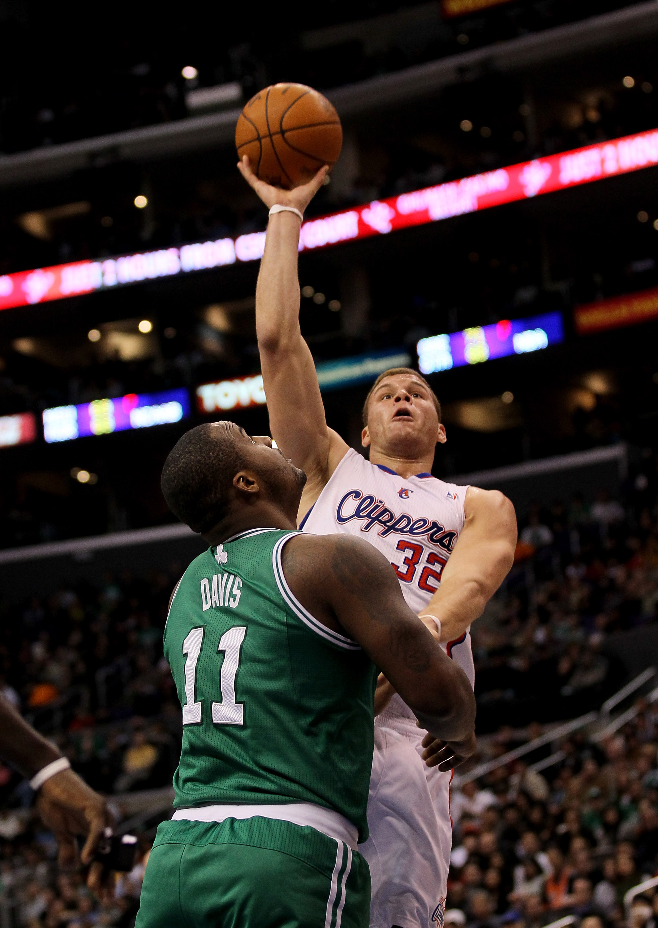 LOS ANGELES, CA - FEBRUARY 26:  Blake Griffin #32 of the Los Angeles Clippers shoots over Glen Davis #11 of the Boston Celtics at Staples Center on February 26, 2011  in Los Angeles, California. The Celtics won 99-92.  NOTE TO USER: User expressly acknowl