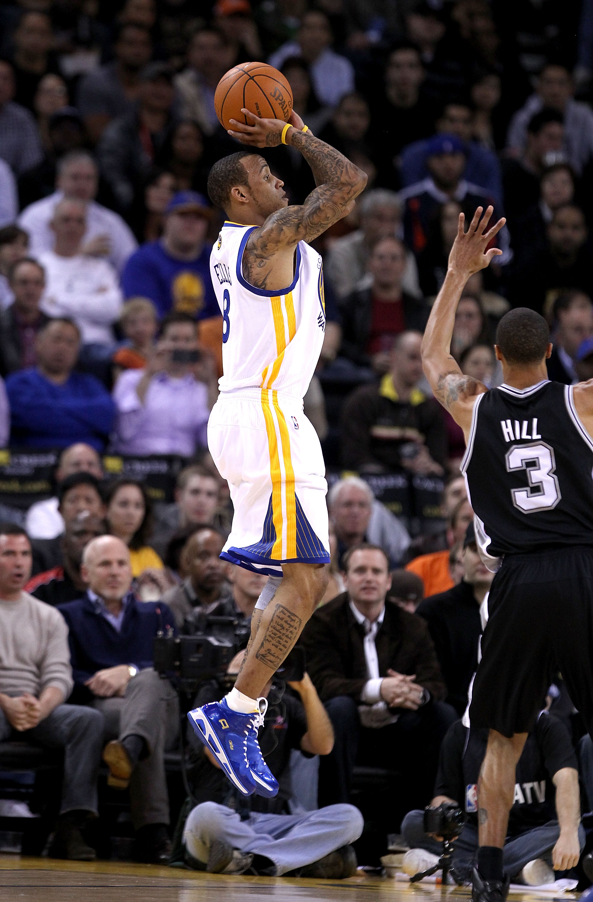 OAKLAND, CA - JANUARY 24:  Monta Ellis #8 of the Golden State Warriors in action against the San Antonio Spurs at Oracle Arena on January 24, 2011 in Oakland, California.  NOTE TO USER: User expressly acknowledges and agrees that, by downloading and or us