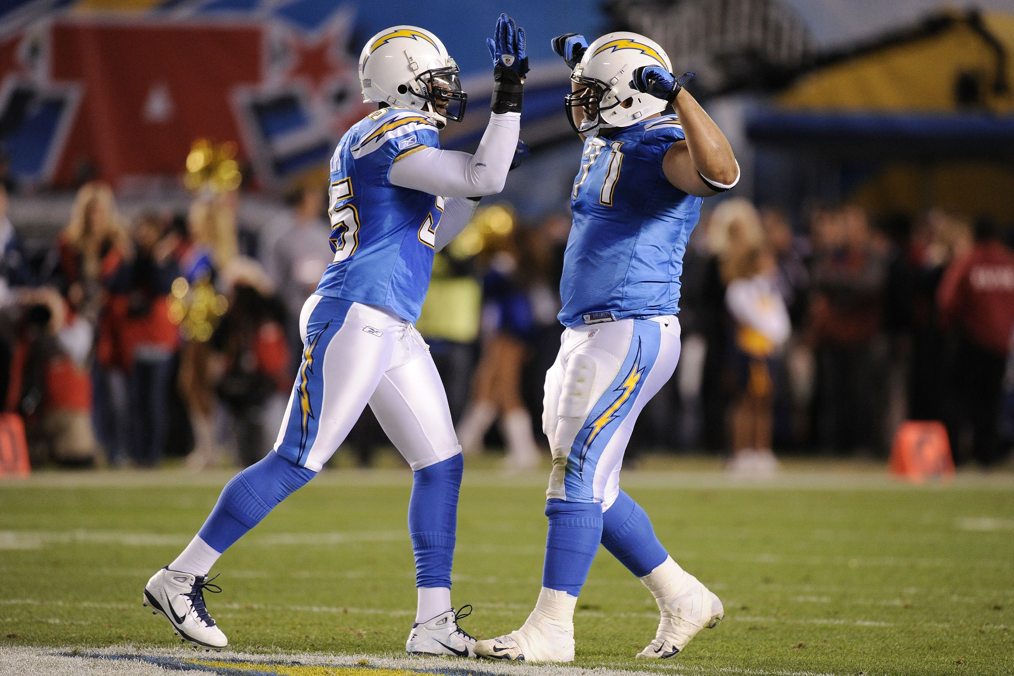 SAN DIEGO, CA - DECEMBER 16:  Defensive tackle Antonio Garay #71 of the San Diego Chargers celebrates with Shaun Philips #95 after a sack of quarterback Alex Smith #11 of the San Francisco 49ers in the second quarter at Qualcomm Stadium on December 16, 20
