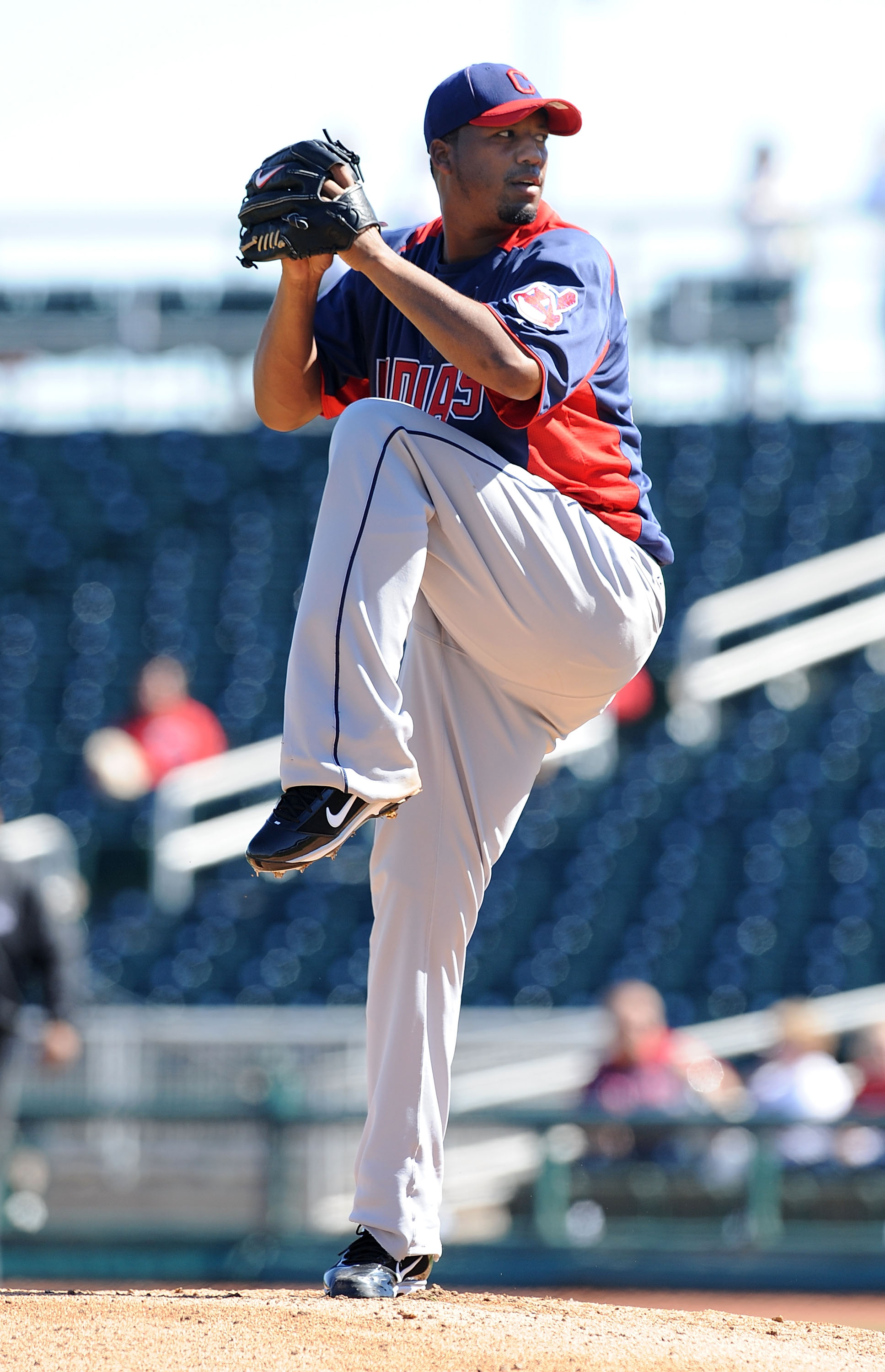 GOODYEAR, AZ - FEBRUARY 28:  Fausto Carmona #55 of the Cleveland Indians delivers a pitch during the first inning against the Cincinnati Reds at Goodyear Ballpark on February 28, 2011 in Goodyear, Arizona.  (Photo by Norm Hall/Getty Images)