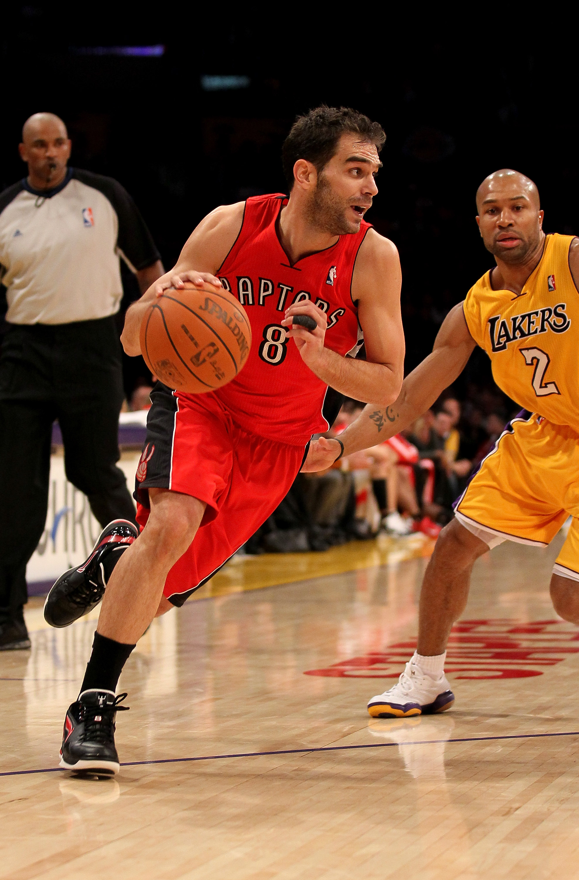 LOS ANGELES - NOVEMBER 5:  Jose Calderon #8 of the Toronto Raptors drives around Derek Fisher #32 of the Los Angeles Lakers at Staples Center on November 5, 2010 in Los Angeles, California.  The Lakers won 108-102.   NOTE TO USER: User expressly acknowled