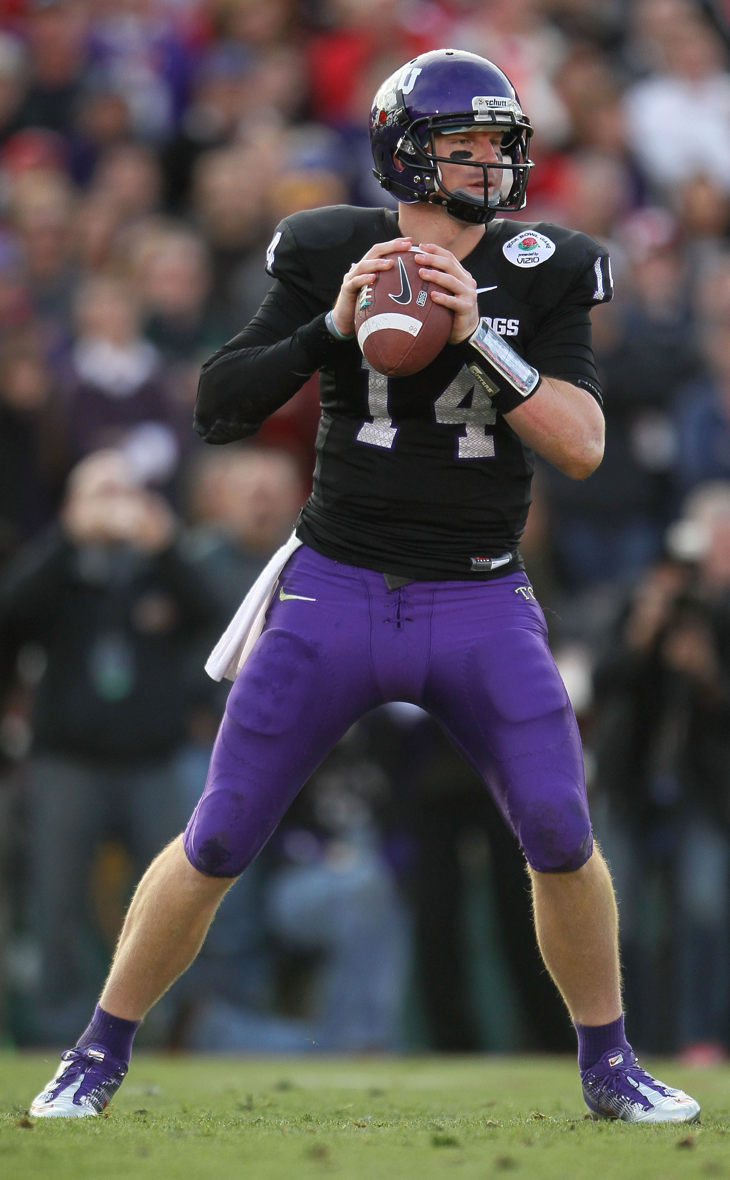PASADENA, CA - JANUARY 01:  Quarterback Andy Dalton #14 of the TCU Horned Frogs looks to pass against the Wisconsin Badgers in the 97th Rose Bowl game on January 1, 2011 in Pasadena, California.  (Photo by Jeff Gross/Getty Images)