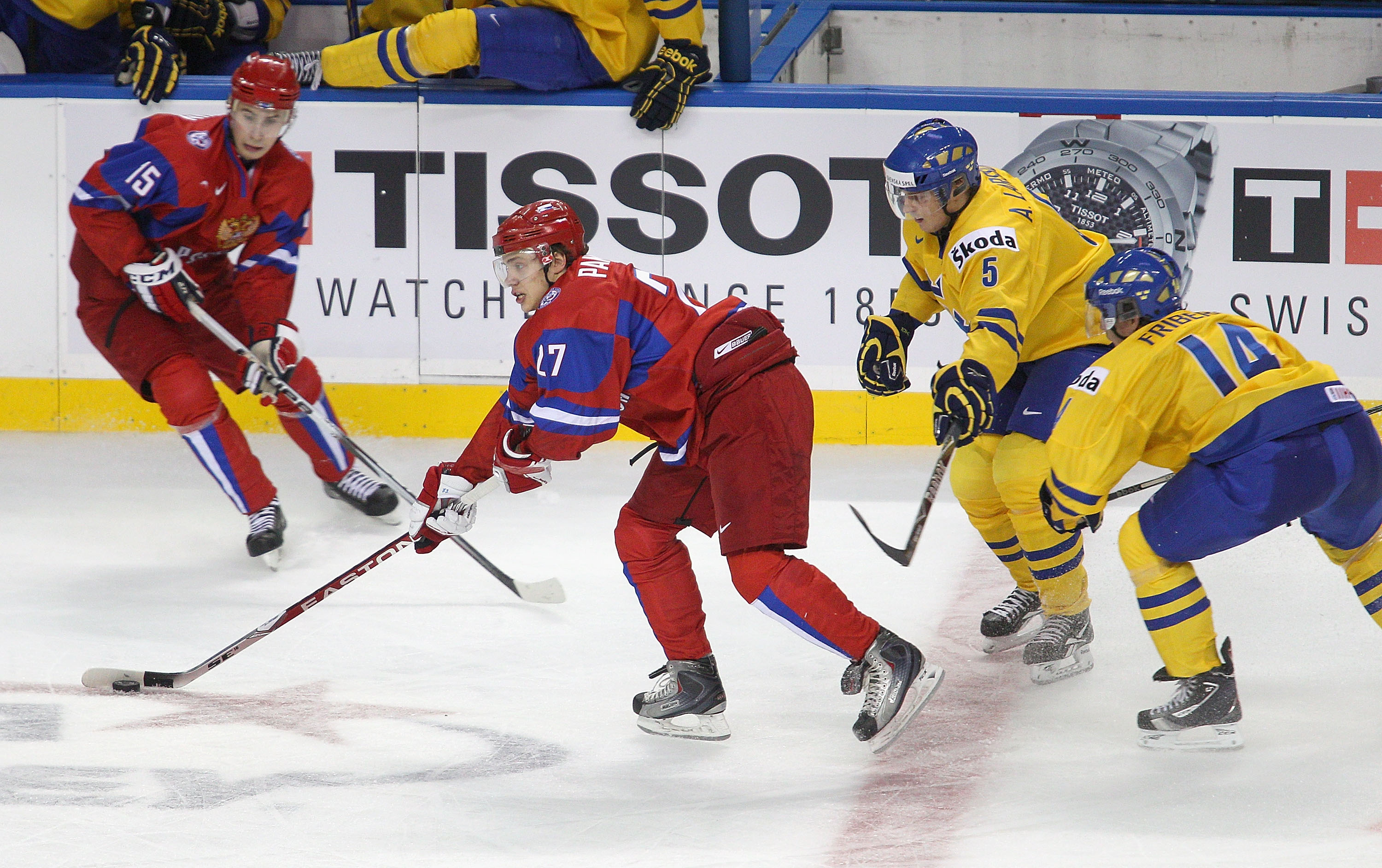 BUFFALO, NY - JANUARY 03: Artemi Panarin #27 and Artyom Voronin #15  of Russia skate against Adam Larsson #5 and Max Friberg #14 of  Sweden during the 2011 IIHF World U20 Championship Semi Final game between Sweden and Russia on January 3, 2011 in Buffalo
