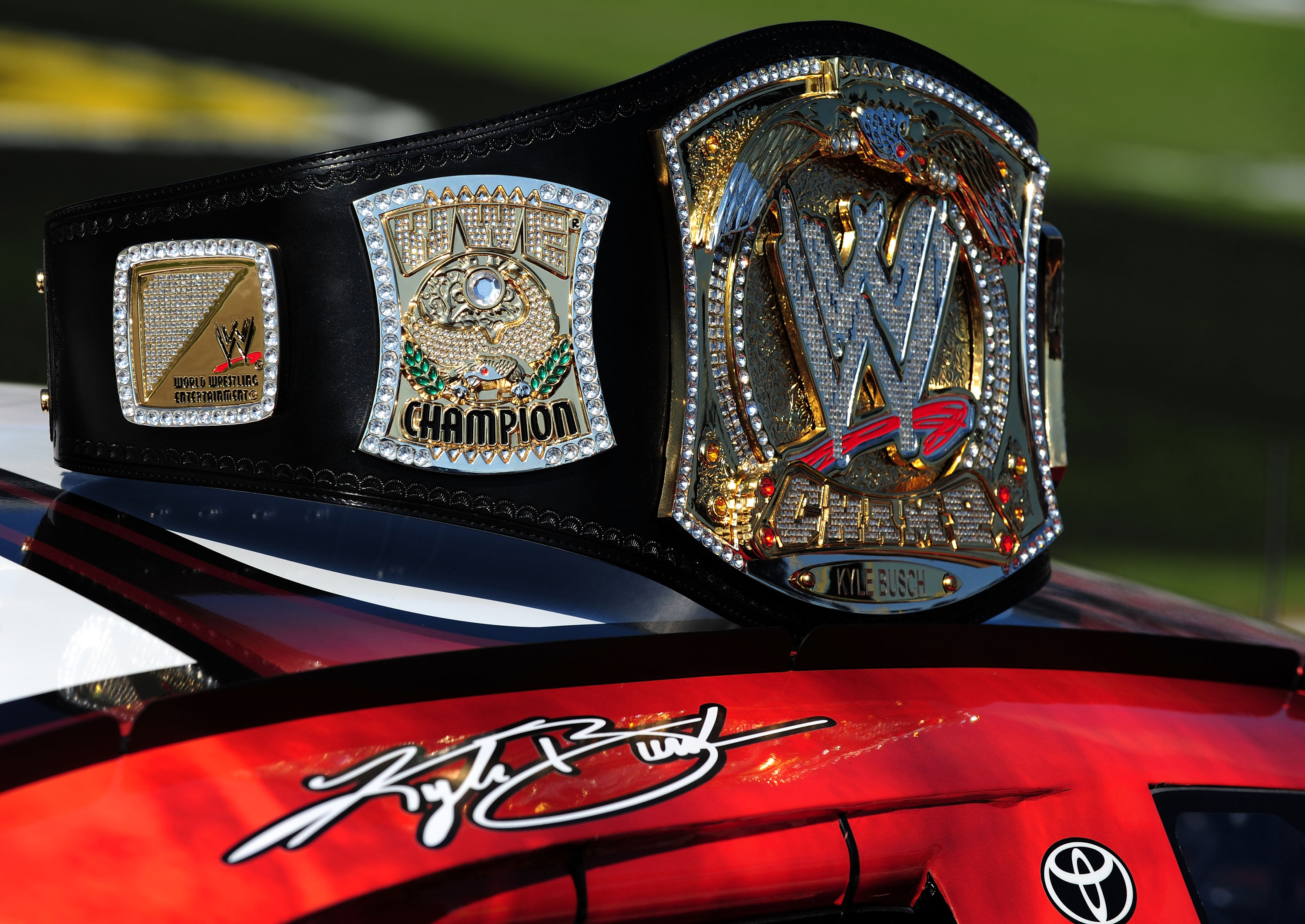 FORT WORTH, TX - NOVEMBER 07:  A replica of the WWE world championship belt rests on top of Kyle Busch's #18 Z-Line Designs/WWE Smackdown Toyota prior to the start of the NASCAR Nationwide Series O'Reilly Challenge at Texas Motor Speedway on November 7, 2