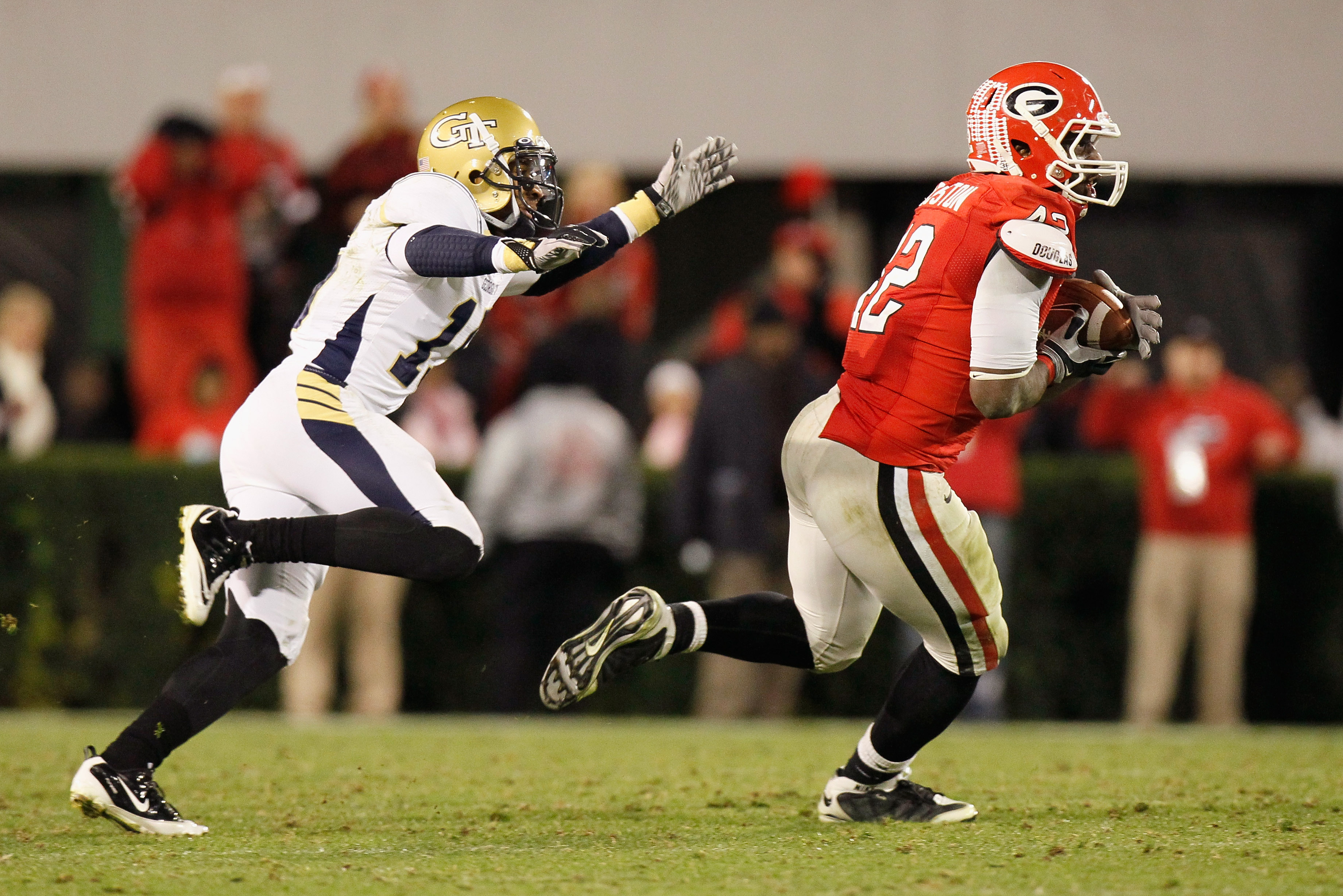 ATHENS, GA - NOVEMBER 27:  Justin Houston #42 of the Georgia Bulldogs intercepts a pass intended for Correy Earls #15 of the Georgia Tech Yellow Jackets in the final seconds of regulation at Sanford Stadium on November 27, 2010 in Athens, Georgia.  (Photo