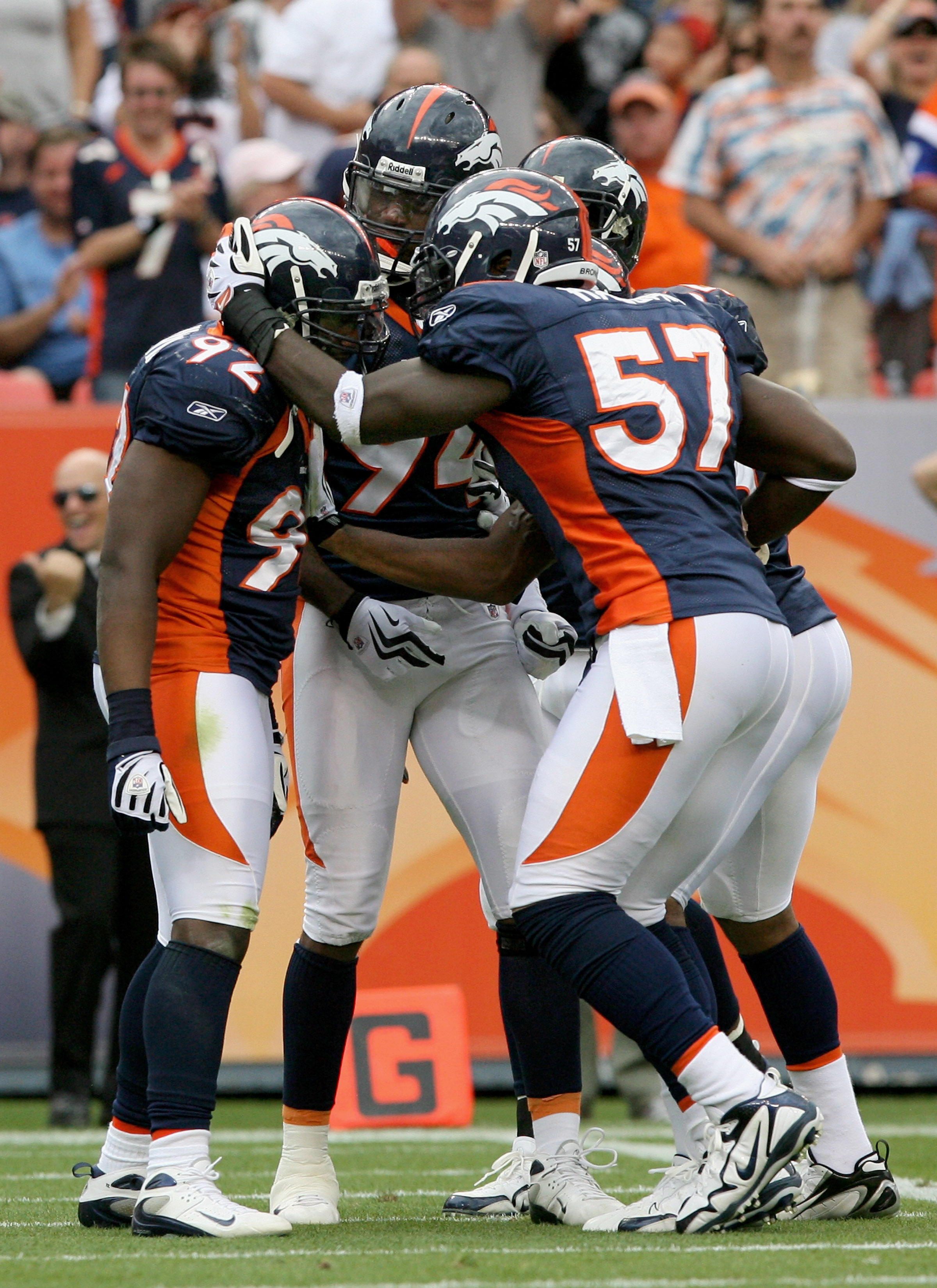DENVER - SEPTEMBER 20:  Defensive end Elvis Dumervil #92 (L) of the Denver Broncos is congratulated by his teammates after he sacked quarterback Brady Quinn #10 of the Cleveland Browns in the fourth quarter during NFL action at Invesco Field at Mile High