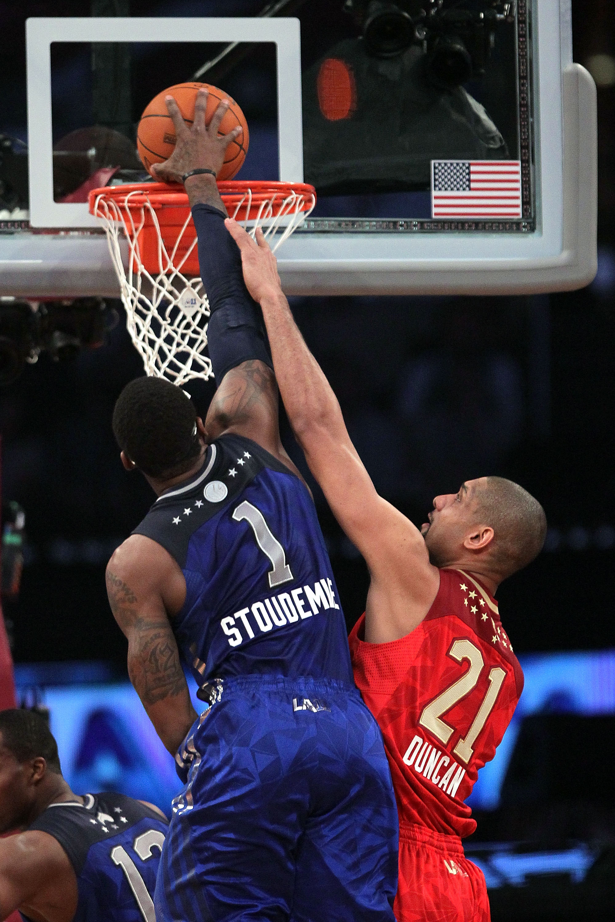 LOS ANGELES, CA - FEBRUARY 20:  Amare Stoudemire #1 of the New York Knicks and the Eastern Conference dunks over Tim Duncan #21 of the San Antonio Spurs and the Western Conference in the 2011 NBA All-Star Game at Staples Center on February 20, 2011 in Los
