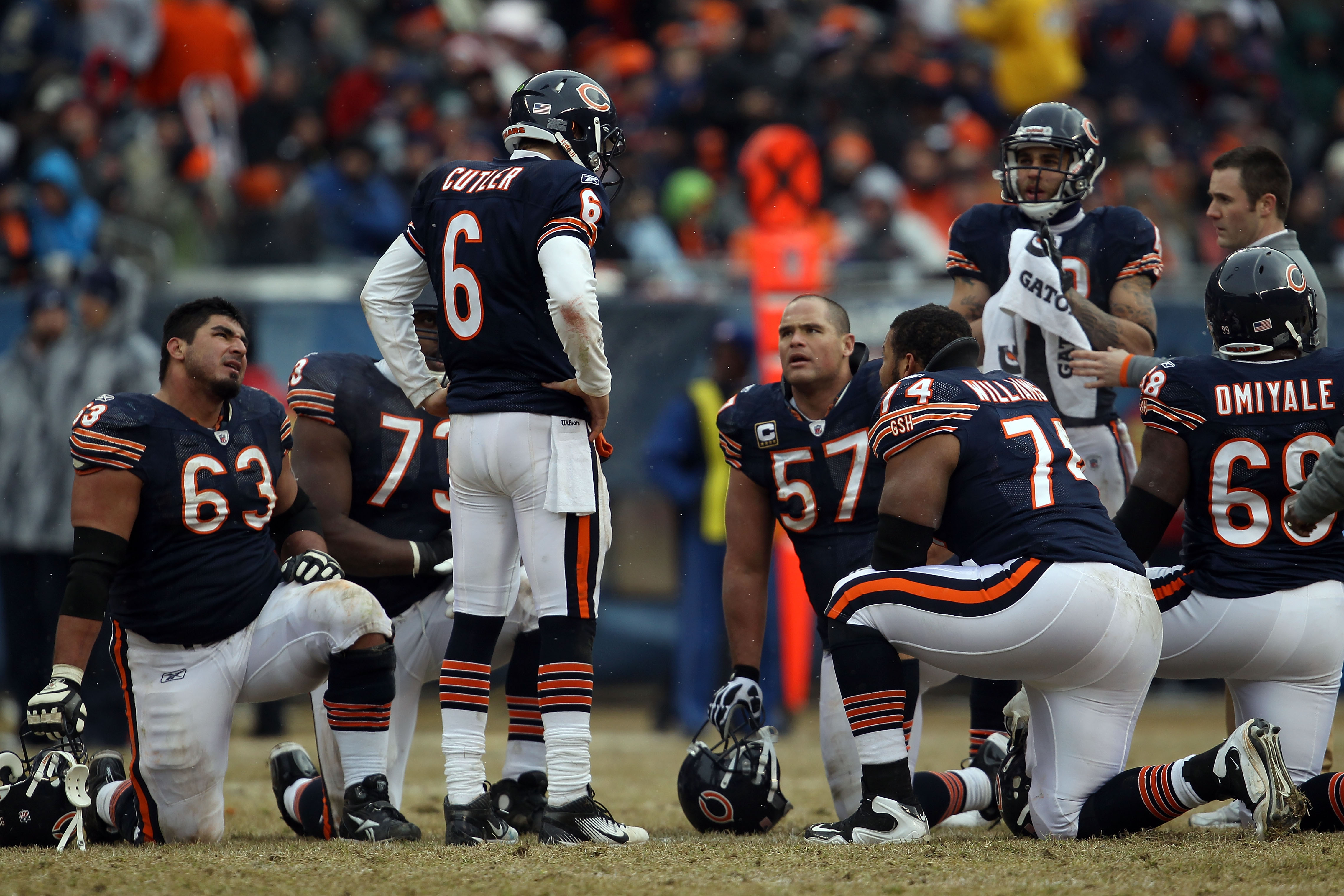 CHICAGO, IL - JANUARY 16:  Quarterback Jay Cutler #6 of the Chicago Bears talks with his offense as Marcus Trufant #23 of the Seattle Seahawks is injured on the field in the second half against the Seattle Seahawks in the 2011 NFC divisional playoff game