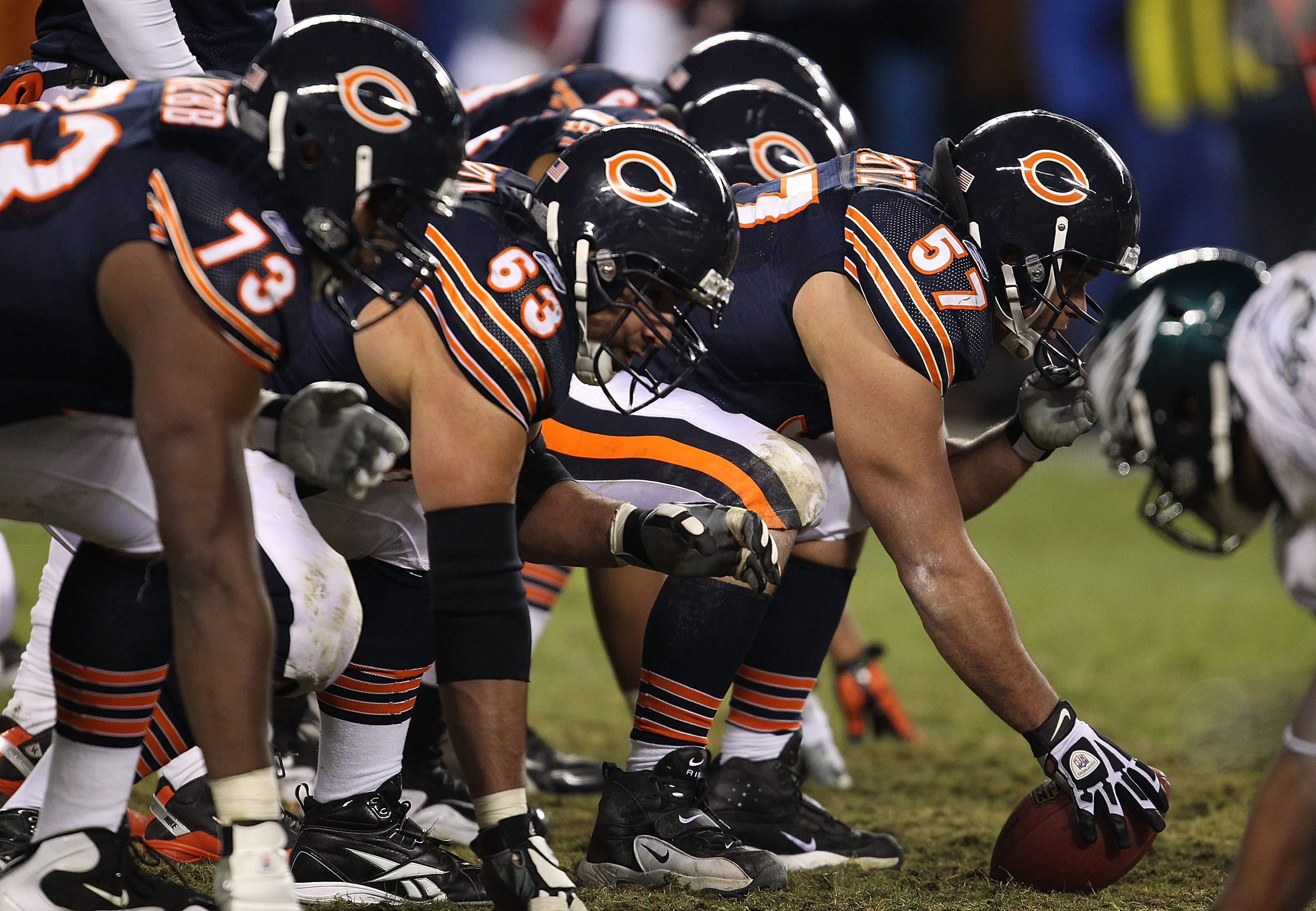 CHICAGO - NOVEMBER 28: (L-R) J'Marcus Webb #73 and Roberto Garza #63 of the Chicago Bears await the snap of Olin Kreutz #57 against the Philadelphia Eagles at Soldier Field on November 28, 2010 in Chicago, Illinois. The Bears defeated the Eagles 31-26. (P
